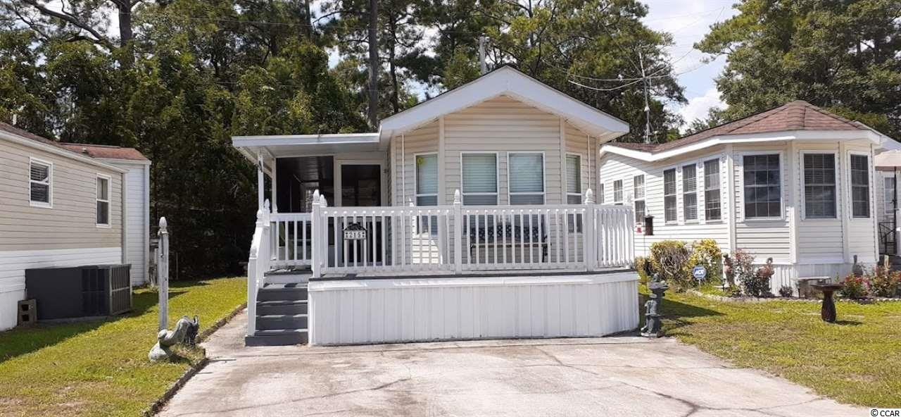 Rare find! This beautifully maintained 2 bed, 1 and a half bath park model unit is perfect for permanent residence, or as a vacation getaway.Only a few steps to marsh and activity center. Located in the very quiet and peaceful Myrtle Beach RV Resort, this home is beautifully decorated in beach themes. Many recent updates including a new hot water heater, 2-year-old AC. The property also houses a detached storage building for yard and gardening supplies and a washer & dryer. Come join our peaceful, gated community at MB RV Resort! Here you will find your piece of paradise within a community that offers two swimming pools, an activities center, basketball and tennis courts, mini-golf, and horseshoes. Enjoy the security of a gated community where you own your land, with low HOA fees. The hoa includes cable, internet, trash, water, yard maintenance, 2 pools, activity center. putt-putt, tennis court, basketball court. This house just a few steps away from the activity center which has a pool, hot tub, kids playground, AND THE MARSH where you can catch flounder and shrimp! There are plenty of windows to welcome in the South Carolina sunshine! This house is ready to move in and includes a full-size washer and dryer, full-size refrigerator, microwave, and a stove. Spectacular grounds with ocean and marsh views. Myrtle Beach RV is a golf cart community that borders the Cherry Grove Inlet.