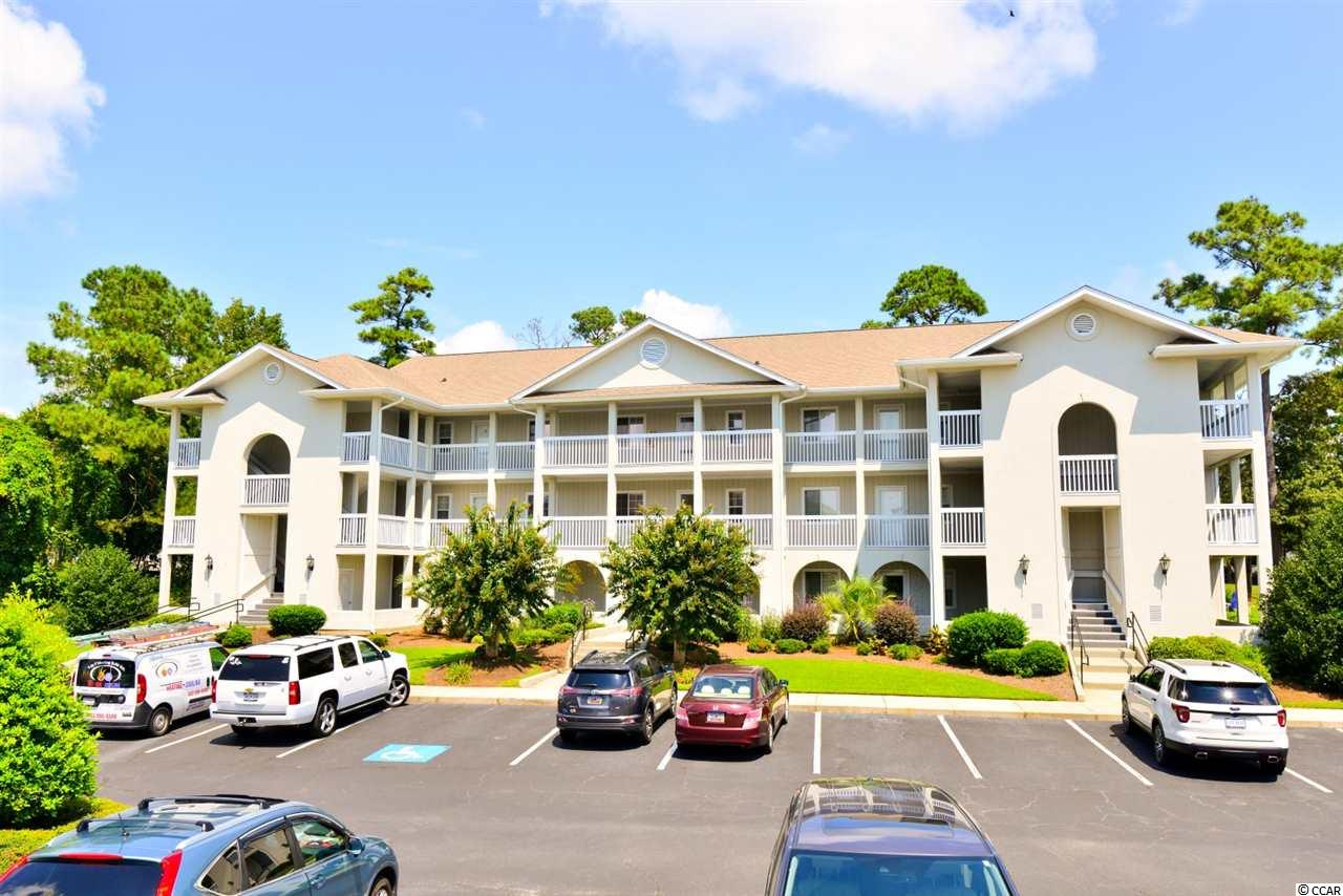 WOW!  This 2 bedroom/2 bath unit in the quiet Spinnaker Cove community is in pristine condition with a golf course view from the cozy screened porch.  Well cared for and very gently used, the HVAC was replaced in 2018, shower heads and disposal in 2019, and the water heater and bathroom mirrors were replaced in 2020.  PLUS the foyer, kitchen and bath floors have been tiled, the kitchen and bar counter tops have been refinished, and it has fresh paint and recently cleaned carpets.  There is a short list of personal property that does not convey, but the unit is being sold all but fully furnished.  The community amenities are an added bonus!   These units have been selling fast, so don't miss your chance to make this one yours!
