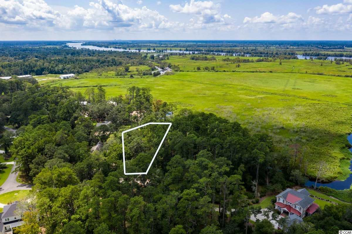 Build your dream home overlooking historic ricefields on this beautiful homesite in Litchfield Plantation., Litchfield Plantation is a private gated community in Pawleys Island South Carolina. It is considered one of the most beautiful places to live as it is the home to 300 year old oak trees dripping in moss. Upon entering the community you will be welcomed by the Avenue of Live Oaks and the original Plantation home that dates back to the 1750s. The community pool overlooks historic ricefields and the private marina with boat slips give you access to the Intracoastal Waterway. Another gem of this community is the oceanfront beach house on Pawleys Island for the use of owners. Capture your own piece of history today!
