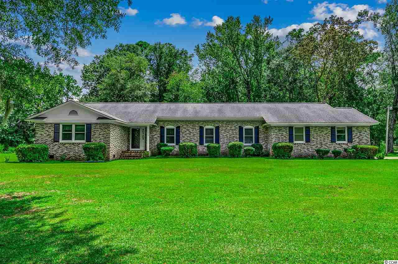 This is your chance to live in a BEAUTIFUL, WELL BUILT, LARGE COUNTRY RANCH HOME, close to everything Conway.  Just minutes away from Hwy 501 - easy access to shopping, theater, banks and restaurants.  2600 Heated Square Feet and over 3500 under roof - everything in this home is BIG!  Living room with fireplace, Great room, formal dining, daily dining area, 3 bedrooms and 3 full baths, foyer, screened in back porch with ceiling fan, office area, laundry room and an oversize garage.  True southern charm shows here in the beautiful 1.3 acre lot with brick column entry,  mature trees and nice landscaping.  Just a few things to look for on your visit - Granite counter tops and stainless steel appliances in the kitchen, tons of storage inside the home and LOTS more in the attic area, pocket doors, built ins, large walk in hall closet, new hot water heater and very clean.  Schedule your showing to through ShowingTime.