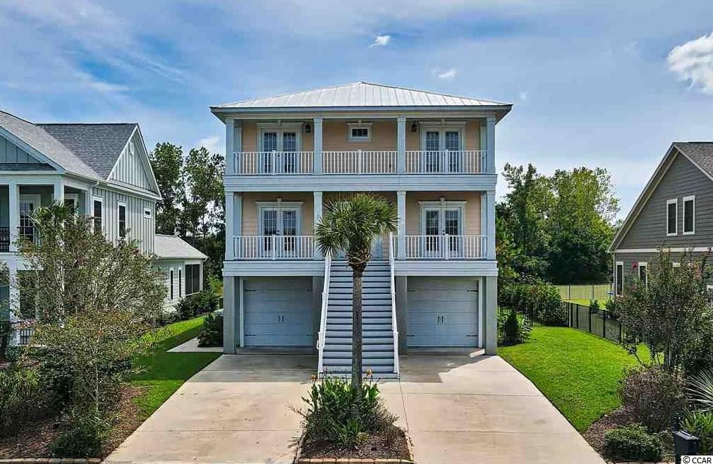 Rare opportunity to own this 3 story Charleston style home in Waterway Palms, located on an over-sized lot.  Featuring a 3 car garage with one pull through double bay.  This garage is perfect for the car collector, mechanic, or for storing your boat.  With the current excessive waiting list for WWP storage, you will never have to be concerned about where to keep your boat. Gorgeous views from any of the 4 decks.  The HOA protected buffer behind the home provides a park like serene setting. There is a first floor mother-in-law suite, which is perfect for family & visitors.  The main floor features a very open floor plan with large kitchen & breakfast nook, formal dining room, office/6th bedroom, half bath, family room, and hard wood floors throughout.  The top floor features a rear master suite, with his/hers closets, walk in shower with multiple heads, jacuzzi tub, and double sinks.  It also includes three additional bedrooms, a full bathroom, laundry room, and hardwoods in the common area. Hardi Plank and all Metal Roof complete the exterior.  Waterway Palms is a 24/7 gated community with an amenities center unlike any in the area.  Featuring resort style pool, tennis courts, basketball court, gym, bocce, cornhole, boat launch, boat storage, day docks, and massive two story amenity building.  Waterway Palms allows quick access to Hwy 31, and just a short drive to shopping, restaurants and the beach.  Square footages are approximate and not guaranteed.