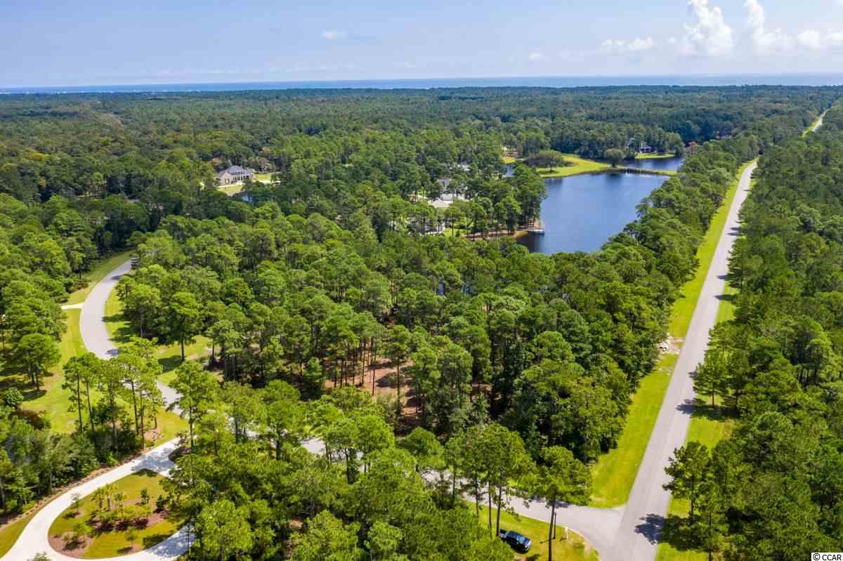 Beautiful 2 acre lot with fabulous long views of the beautiful lake on Ocean Lakes Loop.This corner lot is located on the ocean side of Prince George community with riverside access. Just south of Pawleys Island, the unique Prince George community has only 150 unique single family homesites that stretch from the Atlantic Ocean to the Waccamaw River (Intracoastal Waterway). Prince George offers a wide variety of recreational activities that rejuvenate the mind, body and spirit. The oceanside amenities include a swimming pool, clubhouse, tennis, volleyball and basketball courts, nature trails, private beach access and a 5 acre lake. The riverside amenities include a River Clubhouse with sitting area, fireplace, board walk and 28 slip marina along the Waterway.