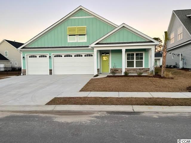 Our fantastic new Emerald lV Model has so much to offer ~ This One & 1/2 story home features 4Br/3Ba with office on first floor & 1 BR/bonus with full bath on the 2nd floor and a large 3 car garage! This open floor plan boasts a large living room, breakfast/dining area, kitchen with free standing gas convection range, over-the-range sensor microwave, energy star dishwasher, granite countertops, garbage disposal, pantry, laundry room & rear covered porch. Fantastic Master Suite with tray ceiling, 2 walk in closets & bathroom with walk in shower, water closet and his & her sinks. The 2nd floor boasts a large bedroom/bonus room with full bath. Energy savings features include Low E windows, 14 Sear HVAC, Digital WiFi Programmable Thermostats, Tankless Gas Hot Water Heater & 200 Amp electrical service, security system with keyless entry.  Too much to mention so come see for yourself! From the time you step onto the quaint from porch & open the front door you'll see the quality of construction. 9' flat ceilings, wide plank restoration flooring, luxurious carpet in bedrooms.  Additionally, Robber's Roost at North Myrtle Beach is a natural gas community east of Hwy 17 with a community pool coming for the 2021 swimming season & is located within walking, bicycle or golf cart distance to Tilghman Beach, the beautiful Atlantic Ocean w/ 60 miles of white sandy beaches and is close to Coastal North Town Center (shopping, dining, beauty, pets), Shag dance capital Main St., golf, boating/fishing in the ICW, entertainment and all the amenities of living in Coastal South Carolina. Whether a primary residence or your vacation get-a-way, Don't Miss ~ come live the dream!  (*Many new plans to choose from!)