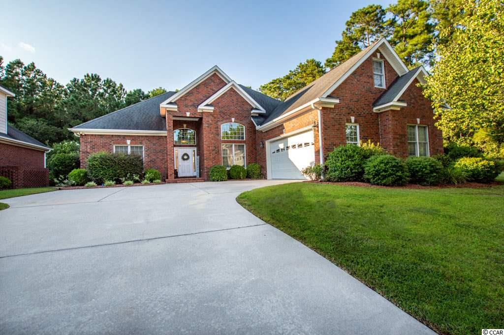 Beautiful Custom ALL BRICK River Hills home with ionized heated in-ground pool for relaxing and entertaining in one of the most private backyards in the neighborhood. This 4 bedroom and 3 1/2 bath home is located in a well established and highly desired golf community in Little River. This property is at the end of a quiet street with no thru traffic. The brick wall and iron fencing in backyard and pool area back up to a beautiful wooded area with tall trees for tons of peacefulness and privacy. The open foyer leads into a spacious living area that boasts all wood floors, vaulted/cathedral ceiling and plenty of recess lighting. It also has a large gas fireplace with custom built-ins on each side and a wet bar with ice maker. The kitchen is open to a nice breakfast nook area with extra seating at the bar. It features granite counter tops, stainless steel appliances, gas stove/oven, spacious pantry and designated desk and shelf area. Separate formal dining area with furnishing to convey. All 3 bedrooms including the master are on first floor and 4th bedroom/bonus room are on the second floor. The large master bedroom has lighted tray ceilings with the master bath (jetted whirlpool garden tub and shower) and walk-in closet attached. The 2 other downstairs bedrooms are connected with a jack and jill style bathroom with a linen closet, shower and tub combo. Upstairs features a bonus room and or 4th bedroom with plenty of space for living and bedroom furnishings not to mention a walk in closet and full bathroom. This home has a spacious 2 car garage with plenty of storage room and laundry area with W/D connection as you enter the through garage. River Hills is centrally located in the heart of Little River just a few miles from waterfront restaurants, shopping, entertainment and the NC/SC beaches.