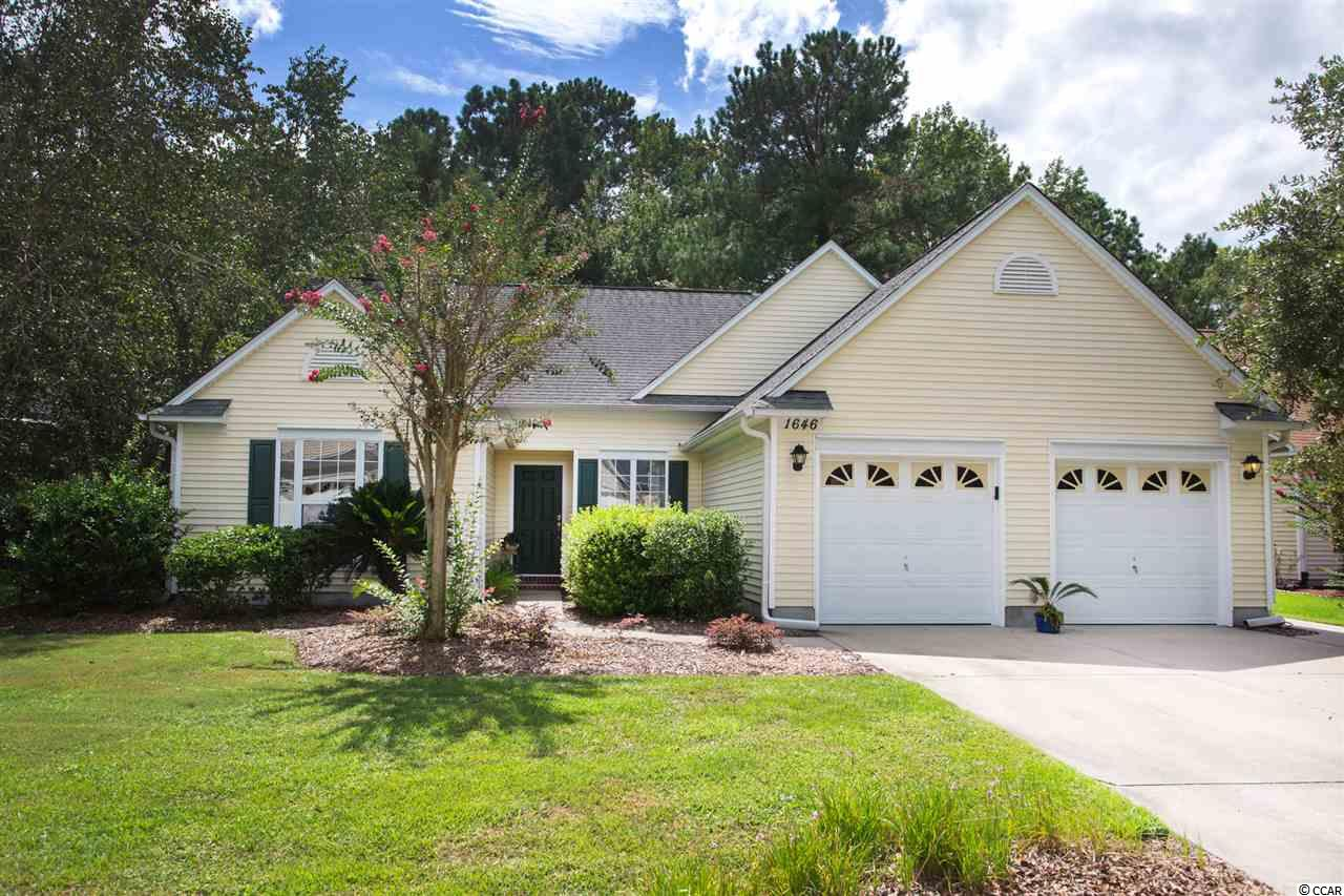 Enjoy the best of Murrells Inlet living in this well-designed home in the popular Indigo Creek community. This 3 bedroom, 2 bath home with 2 car garage has good curb appeal and a park-like backyard overlooking a meandering stream and the 17th hole of the Indigo Creek golf course.   Home features a large living room with vaulted ceiling, fan and skylight bringing in lots of natural light.  Attractive wood flooring in the entry way, hallways, living room and Carolina Room.  Vaulted ceilings create an open and airy feeling and decorative plant shelving in the kitchen adds to the finishing touches.  Start your day in the bright and cheery kitchen with Formica counters, lots of cabinets, breakfast bar, sunny dining nook with bay window, newer tile and stainless steel, range, microwave and dishwasher.  The formal dining room off the kitchen will be great for those special holiday dinners with family and friends.  Split bedroom plan with spacious master bedroom with vaulted ceilings, fan, 2 closets, one a walk-in, and windows overlooking the wooded backyard. Master bath with newer tile, garden tub, separate walk-in shower and palladium window. Guests will enjoy their privacy with 2 good sized guest bedrooms located on the opposite side of the house.  The corner desk in the guest bedroom conveys w/home.  Guest bath with tub/shower.  The spacious Carolina Room with windows all around will be the perfect spot to start your day with your favorite morning beverage.  Or better yet, head outside to the oversized concrete and paver patio with attractive pergola to watch the birds or enjoy nature at its best.  Entertaining comes naturally here. The patio will be great for grilling and entertaining family and friends.  Toward the back of the private, wooded backyard there is a reflection area with chairs, perfect for starting your day or enjoying the evening breezes.  Laundry room with shelving, irrigation system, garage with large custom-built storage cabinet (stays with home) and 