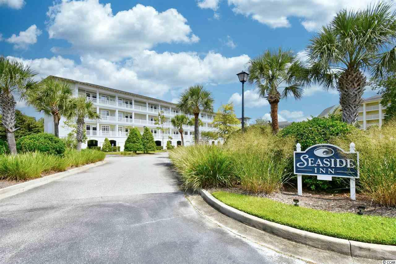 Don't miss this rare opportunity to own this 2 bedroom, 2 bathroom first floor unit with a lock out feature in the highly sought after, Seaside Inn at Litchfield By The Sea. This unit features upgraded flooring throughout, with a spacious open floor plan of the main living areas. Each bedroom offers a ceiling fan, plenty of closet space, and access to its own bathroom. Enjoy afternoons on your screened-in porch, or relaxing at the many community amenities. Being an end unit allows additional windows on the side and the porch is more open. This is an incredible investment opportunity; Rent as one 2 bedroom unit, or separately as two 1 bedroom units. Litchfield By the Sea offers amazing amenities including outdoor pools, tennis courts, a private beach club with private beach access, sun decks, exercise facilities, and more. Conveniently located to all of the famous dining, shopping, golf, and entertainment attractions Pawleys Island has to offer. Whether you are looking for a second home near the beach or your next investment, you won't want to miss this. Schedule your showing today!