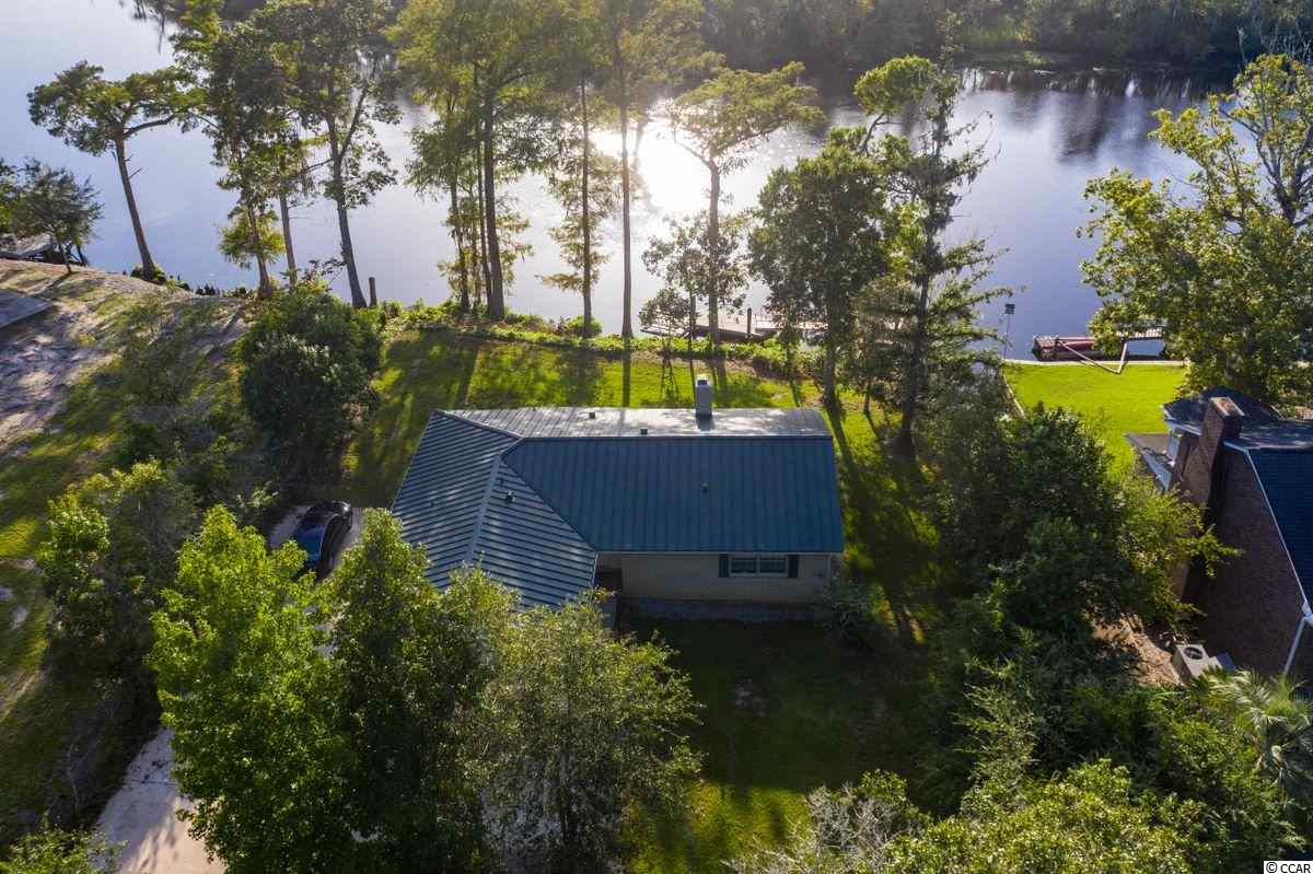 Enjoy gorgeous views from this newly renovated home situated on the Black River with over 100 ft. of water frontage.  The dock and the two attached floating docks are a great harbor for all of your river toys and the original cement bulkhead has been heavily re-enforced with rip-rap and over 180,000 pounds of rock and concrete.  The home itself is virtually maintenance free with a metal roof and an all brick exterior.  There is a two car garage to store any extra gear or to use as a workshop.  Quartz counter tops, new appliances and rosewood floors make for a comfortable place to gather when not outside enjoying the natural amenities!