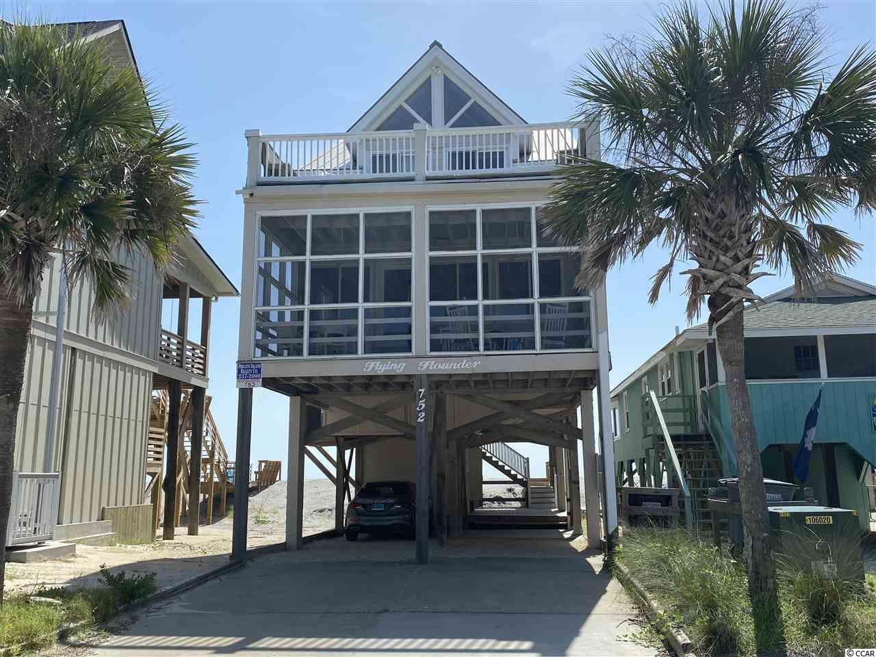 The best in beach home design meets the best in beach location. With ocean front and dock in creek on Pawleys this home built in 1990 was designed by the Architect owner to be the perfect beach home and achieves the goal. Every room offers a view of water, either the Atlantic Ocean or Pawleys Creek. Porches on both ocean and beach sides with decks matching above.  The central open kitchen lets the cook join the party. Great sitting areas on beach or creek side with modern decor that capture the fun and beauty of ocean front living. Spend your day on the beach or on the creek with both only a few feet away. Extra wide beach and great fishing in the creek!  This is what Pawleys is all about. Join our proud owners with this wonderful income producer that will be your family and friends favorite place for years to come. There is no HOA or dues on Pawleys!
