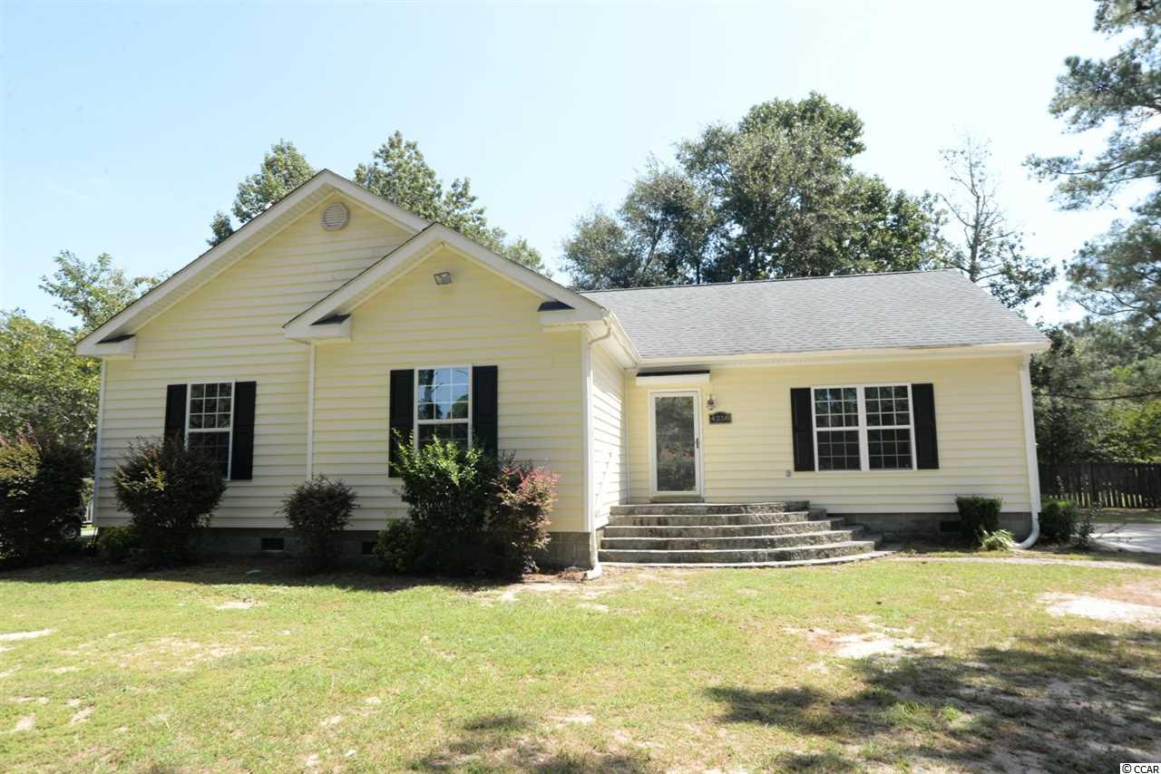 Large four-bedroom, 2-bathroom, home on an extra large lot in the Graystone community in Little River, SC next to the SC/NC state line. This home is in a great location with an open concept, large bedrooms, laminate flooring, large windows to let in lots of light, laminate flooring, tile flooring, nice cabinetry, large master bathroom, double sinks, separate tub and shower, walk in closet, flat ceilings and so much more! Close to Cherry Grove (North Myrtle Beach), Sunset Beach and Calabash, NC.