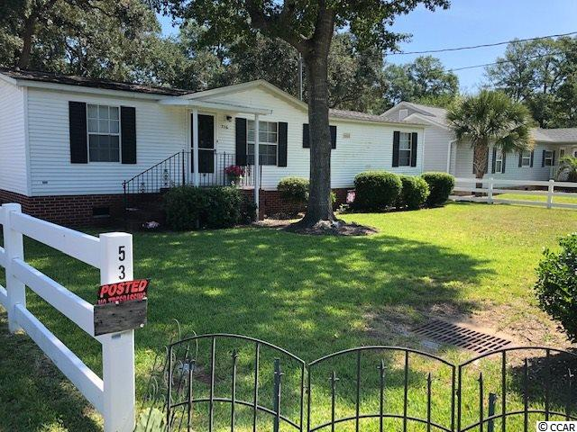 Looking for a home at the beach? Well here's your opportunity. Golf cart to the beach from this beautifully maintained 3 bedroom 2 bath home on a corner lot. Sold fully furnished ready to make it your relaxing home at the beach. Just bring your tooth brush. Screened in Carolina room, large outside storage shed. This home has a large master bedroom with spacious master bath with walk in shower.   Split bedroom floor plan for owner privacy.  This home checks all the boxes you and your family needs. So bring your beach chairs, have fun and rince off with your outside shower.