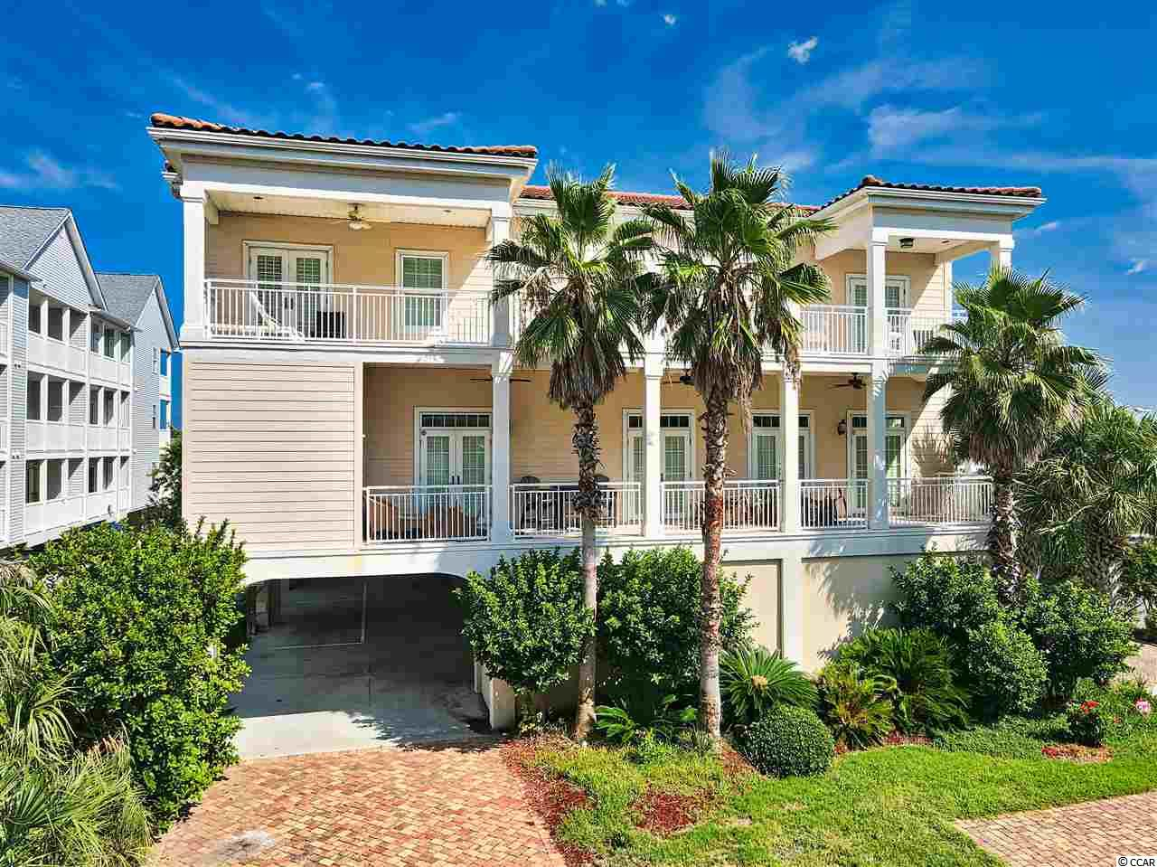 Private Townhome with a private entrance, small 4 unit building with a pier, lots of space for the entire family with each bedroom having its own bathroom. Beautiful luxury Mediterranean style 5 bedroom 5-1/2 bath Townhome in the Cherry Grove section of North Myrtle Beach. Great location - just across the street from the ocean and definitely a rare find. High ceilings and crown molding throughout, over-sized rooms, hardwood flooring in the living area, tile in baths and an elevator. The living area features a fireplace, built-ins and wet bar for your enjoyment. Kitchen features granite counter-tops, SS appliances, breakfast bar and ice maker. Relax on the balcony and enjoy the views of the blue Atlantic.  If you have been looking for the ultimate in luxury your search has ended. This is it!
