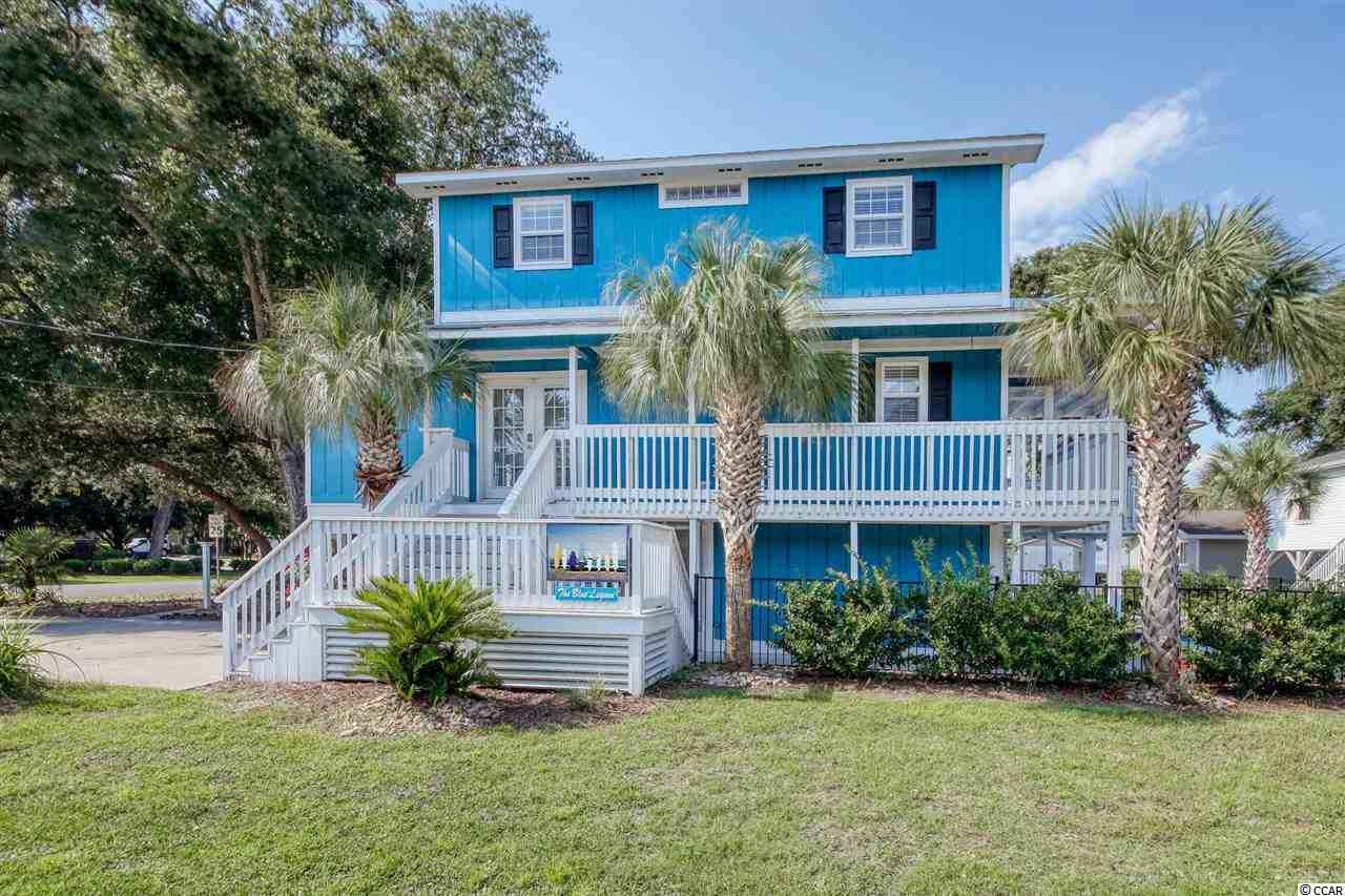 JUST A GOLF CART RIDE FROM THE OCEAN AND BEAUTIFUL, SUNNY DECKS OVERLOOKING A SPARKLING BLUE POOL with tropical landscaping invite you to enjoy every season of the year in this luxurious, fully-renovated 3 BR, 2.5BA beach home in Cherry Grove. Located near Myrtle Beach attractions and just steps from the beach, this elegant home includes indoor and outdoor living spaces to live a relaxed, coastal lifestyle. This lovely home is inviting with freshly painted exteriors, an open floorplan, new furnishings and upscale décor. A gourmet kitchen opens to the warm and cozy living room space with a fireplace. Four bedrooms and three baths, each decorated in soft colors, create a pleasant vacation atmosphere for family and guests. Multiple French doors and brand new, custom inlaid light wood flooring create a breezy and bright ambience throughout the home. A new HVAC system and multiple ceiling fans keep the home comfortable with clean indoor air.  Stainless steel appliances, sophisticated granite countertops, and a large central island provide endless possibilities for family meals and gatherings. Ample space under the home is ready for your beach gear and bicycles, and the golf cart in there conveys with the house. Palm trees greet you every morning on your front deck, and the sea awaits your visit in the afternoons. This completely furnished, wonderful beach property is ready to be your beach home or investment!  North Myrtle Beach offers tranquil beaches, a plethora of restaurants, championship golf courses, the Duplin Winery, the Alabama Theater, and Barefoot Landing (an outdoor, waterfront shopping experience).