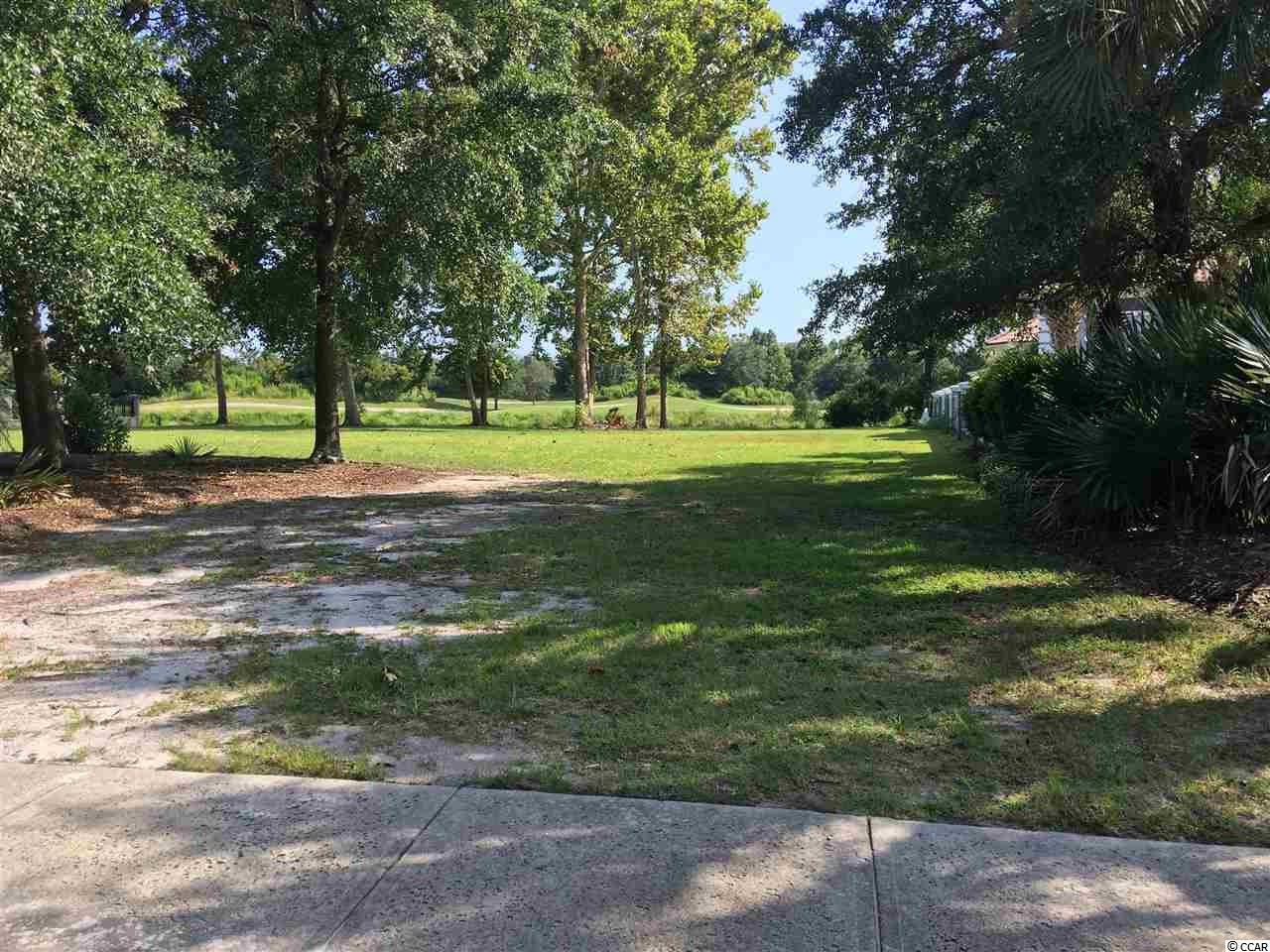 Large Beautiful Lot with Lake and Golf Course view.  A lakeside retaining wall expands the usable lot size substantially.  Multiple mature trees gracefully shade portions of the lot.  Very little view of neighbors add to the natural scenery and privacy.