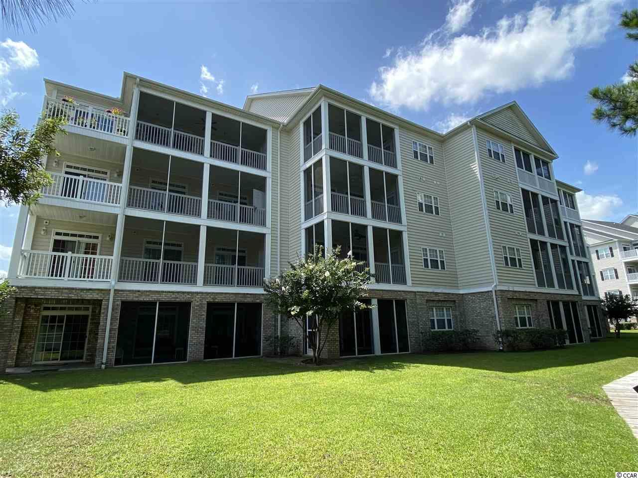 Gorgeous views from this lovely 3 bedroom, 2 bath condo located in the gated community of Villas @ International Club in Murrells Inlet.Fully furnished, move-in ready condo,  enter the condo into the foyer with crown molding and tile floors. Open floor plan with spacious living room with fan. Kitchen with white appliances, pantry, extra cabinets, tile and breakfast bar. Laundry room with washer & dryer that convey and storage closet. Split bedroom plan with large master bedroom with tray ceiling, crown molding, walk-in closet and windows overlooking the back yard. Master bath with tub/shower and crown molding. There are two good sized guest bedrooms at the front of condo. Both bedrooms have carpet and tray ceilings.  2 sliders from the living room lead to the screened in porch overlooking the tree-lined 13th fairway of the International Club Golf Course with lake/pond view. What a great way to start or end your day – sipping your favorite beverage and enjoying the peaceful views of the golf course and pond. The Villas @ International Club is a gated community with walking paths, ponds with fountains, gazebos and a great pool. Conveniently located, close to Huntington Beach State Park, Brookgreen Gardens, the Murrells Inlet Marsh Walk, dining, shopping, medical facilities and just a short drive to the beach! You can walk to the International Golf Course to take in a quick round of golf or enjoy breakfast or lunch at the clubhouse. Perfect for a primary home or vacation home, this condo is only a short drive to the beautiful blue Atlantic Ocean. Buyer is responsible for verifying all measurements and square footage.