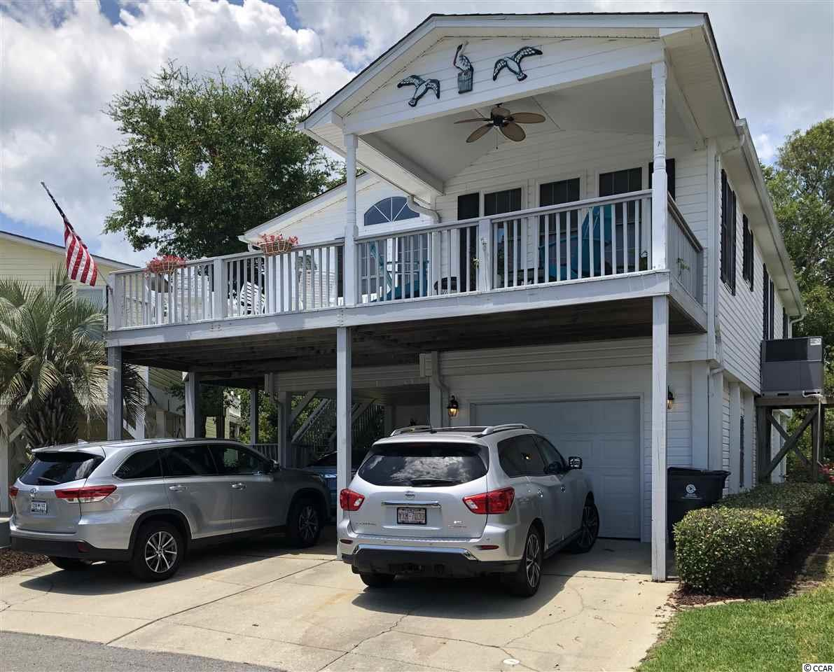 Beautiful raised beach home with huge enclosed storage below for your golf cart, surfboards, beach chairs or workshop. Three bedrooms, two baths, huge porch, and a golf cart ride to the gated oceanfront parking. Make your beach memories here. Fully furnished and ready to enjoy. The Keys are a beautiful section of Oceanside Village, which offers indoor pool, library, fitness center, dog parks, lots of green areas for sports, tennis, two outdoor pools with Splash Pad, and so much more. Don't miss this opportunity to have your own beach home, all ready to go!
