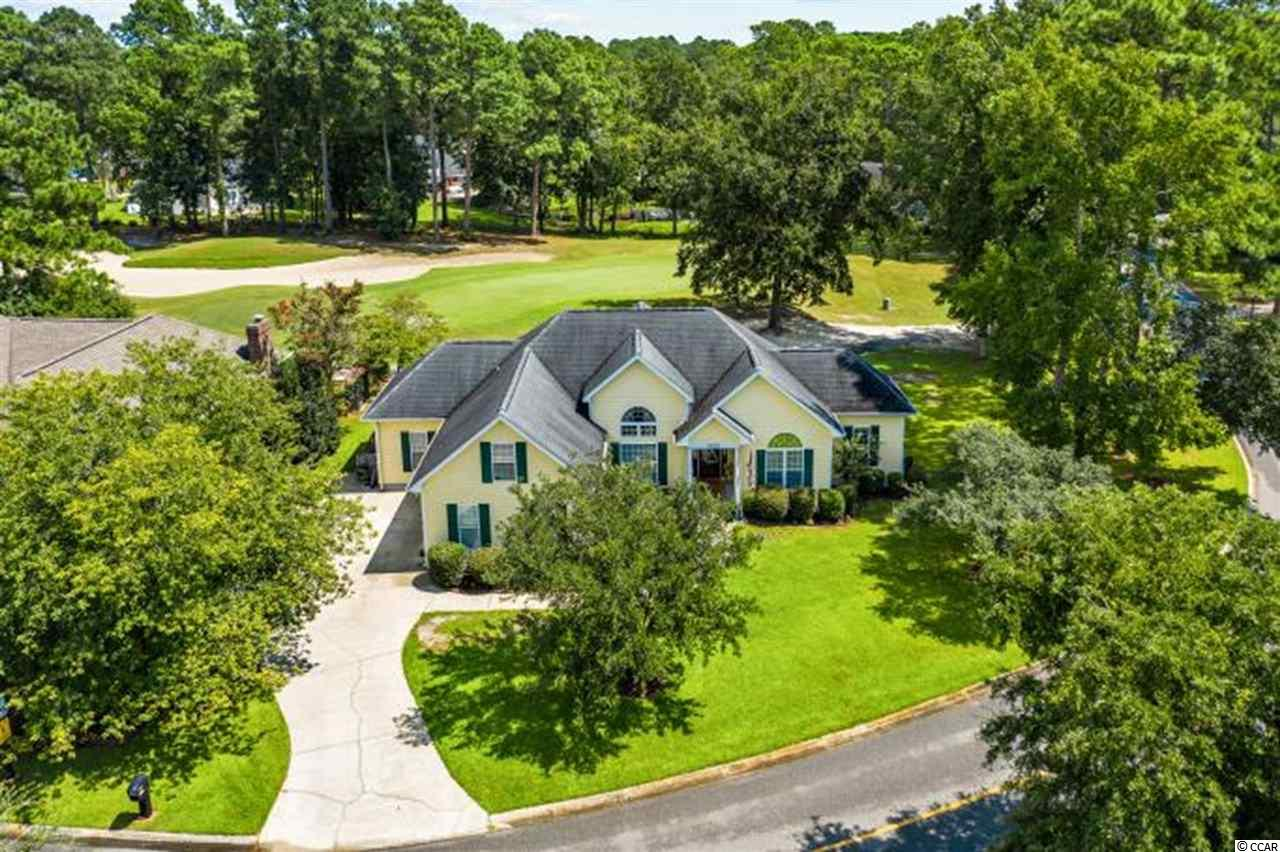 """Nestled away in the northernmost corner of South Carolina, just minutes away from North Myrtle Beach and the Grand Strand, this beautiful home is situated in the coastal town of Little River, home of the famous Blue Crab Festival. With just a short 5-mile joy ride to the beach, River Hills Golf and Country Club is a prestigious, well established sought-after community known for 392 acres of beautiful rolling landscaping. Boasting a well-manicured golf course, ponds, natural wooded areas, and a whimsical winding creek throughout, the property at 3150 Hermitage Drive is proudly situated on a large parcel corner lot enjoying a picturesque view of the 15th green. This beautifully maintained home has a captivating open design with a seamless flow through all public areas. The upgraded granite kitchen is the center of all activity and opens to the spacious living area with vaulted ceilings and a see-through island propane fireplace. The formal dining makes a lasting impression with a 12' arch window and sleek all-around chair rail. The sun-filled Carolina Room with cathedral ceilings features 2-walls of windows overlooking a tranquil wooded area. This Carolina Room spills into the """"bistro-like"""" eat-in kitchen which offers a picture- perfect view of the short par 3 hole. The large sliding door leads to a quaint sitting porch perfect for morning coffee, and a front seat view to all the greens action. Another surprise is the family bonus room over the garage equipped with a quality large combination pool table, air hockey and ping-pong table which will convey to the new homeowner. With this home's brilliant floor plan, it will serve any family's dynamic with endless possibilities. Worth highlighting is the over-sized master bedroom with tray ceilings, walk-in closet with shelving and stately master bath with granite top dual vanities, jacuzzi and walk in shower. The split bedroom plan boasts 2 additional bedrooms on the opposite side of the home and a unique additional space"""