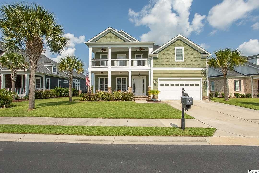 "Looking for a charming home with lots of space in a gated waterway community?  This 5 bedroom 3.5 bath home has a quaint, low-country feel with high-end finishes.  You will notice this in the stone accents around the home and on the welcoming front porch.  As you walk into the front door you are greeted with a cozy foyer area.  There is a custom ""drop zone"" closet to your right and on your left you enter into the open living area.  Here you have several windows that allow for abundant natural light.  Next to the living area you have a dining area that is lined with custom Judges Panel.  As you continue towards the back of the home you will find a fully functioning kitchen with granite counter-tops and stainless steal appliances.  Off of the kitchen you can access the screened back porch.  Making your way back through the kitchen and down the hall you find the bottom level Master suite.  The Master suite has hardwood floors, trey ceiling, a phenomenal walk-in closet with custom cabinetry.  You will find tiled shower and jacuzzi tub in the master bath as well.  Other noticeable features downstairs include a spacious laundry room, nicely situated half-bath, closet space, bar area in living room, and entrance to the attached 2 car garage.  Using the wood stairs you end up in a vast open flex room.  This room could be used as a massive bedroom or entertainment space.  In addition upstairs you will find 4 roomy bedrooms and a second story balcony.  Other noticeable things with this home includes.  Patio in the fenced in back yard; perfect for grilling, additional storage space in the garage with pull down stairs, almost new roof and HVAC (built in 2015).  Waterway Palms is a gated Intra-coastal Waterway community with amazing amenities to include huge swimming pool, grande clubhouse, boat landing with day dock, boat storage, and tennis courts.  Conveniently located; minutes from all local beaches, shopping, dining, and hospitals."