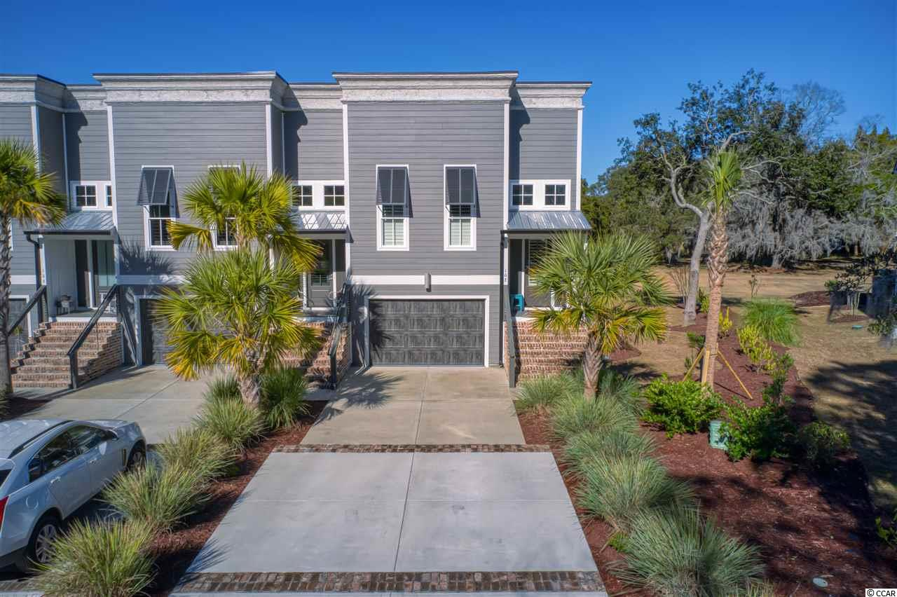 """Historic Litchfield Plantation townhouse, 3BR/2BA, recently built in 2018, that offers the unique look of exposed vents and wood ceilings, like you might find in an old Charleston setting. These units offer a modern design, including separate refrigerator and freezer, gas cooking, deep farmers sink w commercial faucet in kitchen. Quartz counter-tops and subway tile along w stacked cabinetry accent the designs. Also, you will find """"sliding barn door"""" closings on the kitchen spice cabinet, the master bathroom, and in a downstairs bedroom. The garage and screened porches have epoxy painted flooring, and the patio has synthetic planking making all areas clean and finished. Enjoy the cozy relaxing lifestyle that Litchfield Plantation offers, whether at home, or by the Plantation pool, on a bike ride or stroll, or maybe even going over to the Pawleys Island beach house that owners have access to as well. Perfect place to call home and invite friends and family."""
