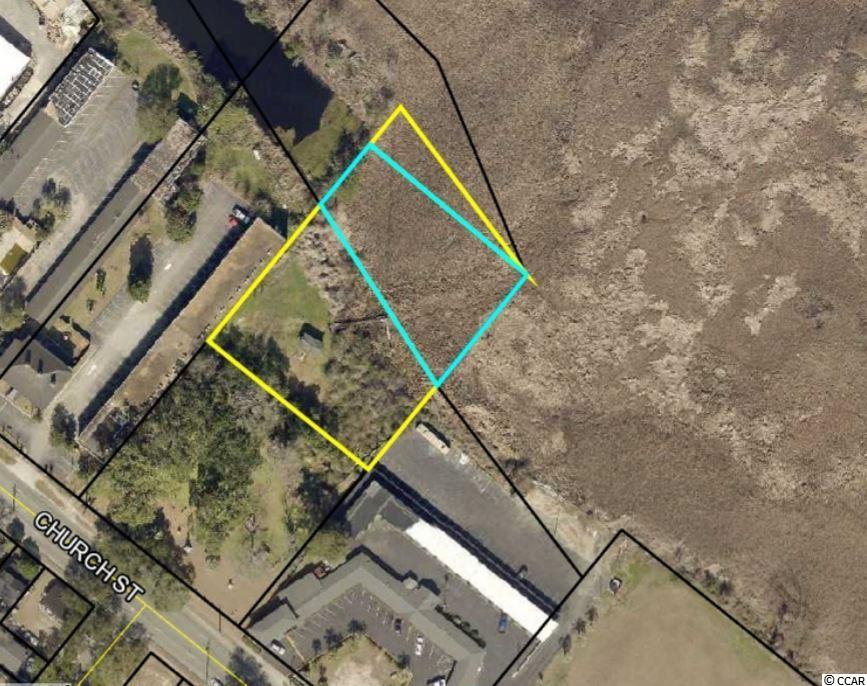 Parcel is located on the marsh and has beautiful views.  Adjacent to new condo complex in downtown Georgetown. Radio tower will be removed by seller. Excellent location for office building.