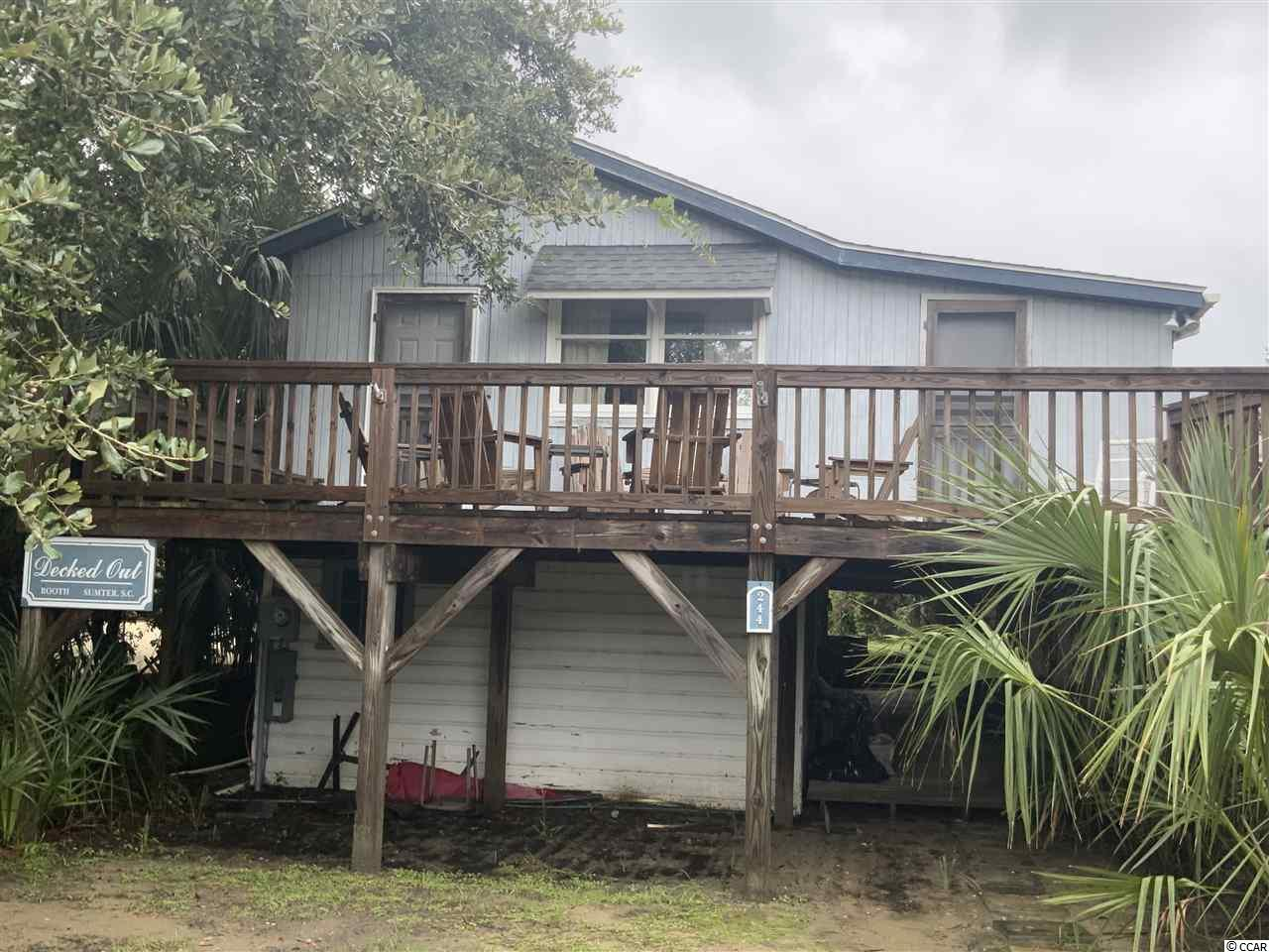 This is the perfect arrogantly shabby home nestled in the heart of Pawleys Island.  It is on ocean side of Atlantic Ave, with a easy walk to the beach.