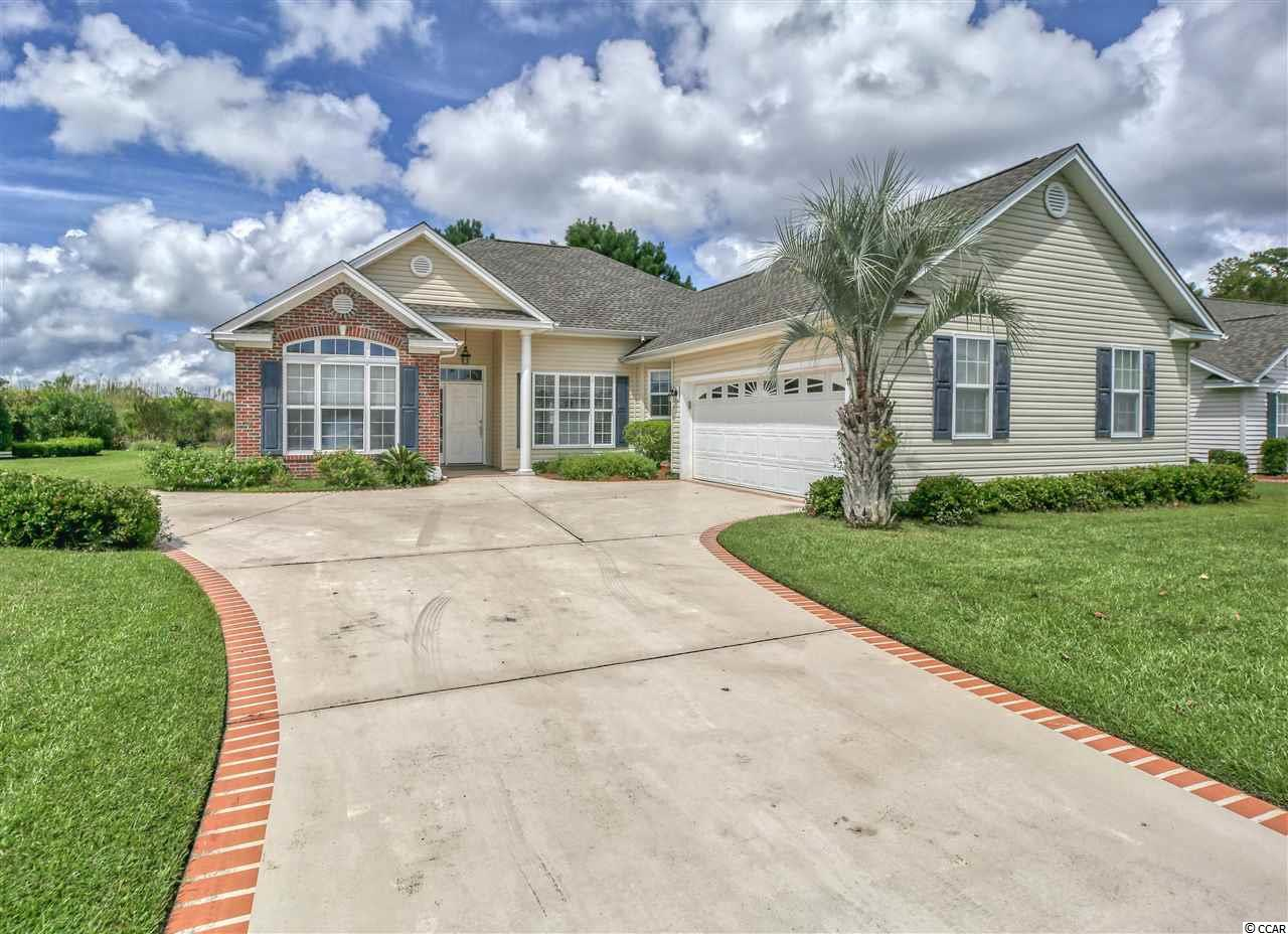 A charming home in the established neighborhood of Southwood located in Surfside Beach with convenience to shopping, restaurants and the Blue Atlantic.  This 3 br/2 ba split floor plan home features  a two sided gas fireplace, 10 ft ceilings,  dining room, large kitchen with island, stainless appliances, pantry, breakfast area and plenty of counter space for cooking and entertaining.  The cozy keeping room off the kitchen has the other side of the gas fireplace and from there you will find a sunlit 11 x 14 all seasons room that leads out to a patio and beautiful back yard.  Trey ceiling in the master bedroom with walk in closet, expansive double sink/vanity with jetted tub and separate shower.  The laundry room comes equipped with washer/dryer and the oversized garage has a side entrance door, utility sink, pull down stairs for attic storage and remote opening.  New roof, extra parking in drive and walking distance to community pool.  Furniture could be included if buyer desires.