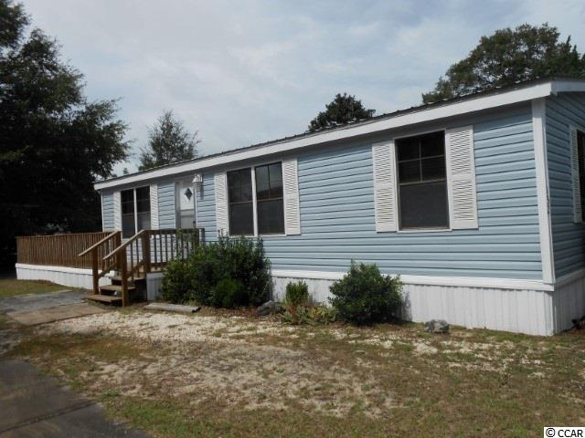 Spacious 3br/2ba Doublewide home in beautiful 55+ community at Capt Cove! Split bedroom plan! Master bath has double vanity, garden tub/shower combo and walk-in closet! Lots of upgraded kitchen cabinets! Lots of windows for extra light throughout! NEW BA Sinks, toilets, ceiling fans throughout and some flooring all replaced in 2018! NEW METAL ROOF and vinyl siding in 2018! Hardwood floors in Kitchen, Shutters, mobile home skirt, & carport cover all within 9 y/o! Skirt & Shutters well maintained and freshly painted in 2018! All appliances only about 9 y/o! Double-sized linen closet in hallway for extra storage! NEW 2018 Over-sized, wrap around deck for outdoor enjoyment! Covered parking for 2 vehicles plus room for 1 more on the side! Nice size Lot in the back for cook outs, etc..!! Close to Hunting State Park, beach, restaurants, shopping and more! Sold As Is! Make an offer!