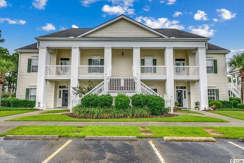 Do not miss this single-level, first-floor end unit in Windsor Green! Nestled sweetly within Carolina Forest, one of Myrtle Beach's most highly sought-after areas, this light-filled, free-flowing condo makes it easy to imagine your life here. Enjoy a split-bedroom floor plan, sliding glass doors leading to your 7'x22' screened porch and 10'x10' patio overlooking the pond. This charming three-bedroom, two-bathroom unit has ample storage and spacious private and common living spaces highlighted by the beautiful flooring and upgraded features throughout. The open foyer impresses from the moment you enter with crown molding accenting the tray ceiling. This welcoming space divides the first two spacious bedrooms, a large laundry/utility room with newly added shelving, and a full bathroom from the common living areas. Moving through the foyer, the open floor plan leads directly into the large living room featuring a ceiling fan and view of the pond. To the right is the kitchen, complete with kitchen cabinets that were refinished and outfitted with pullout racks, two pantries, new garbage disposal, custom backsplash, and appliances that have been replaced within the last four years. The dining area provides plenty of space for entertaining while enjoying company in the other common areas or taking in the view of the pond. The large master suite features a tray ceiling, fan, large walk-in closet, and private access to the screened porch. The ensuite master bathroom has dual sinks featuring new faucets, a vanity space, a whirlpool tub, and a separate shower. Additional upgrades include tinted windows throughout, all updated light fixtures, new blinds within the last four years, all new electrical outlet switches and covers, door stops, water heater (2016), HVAC, smoke detectors, new screened doors, stamped concrete, and the roof (2018). Two unique features in this unit are the air filtration system and water filtration system. The air system is designed with two filters to r