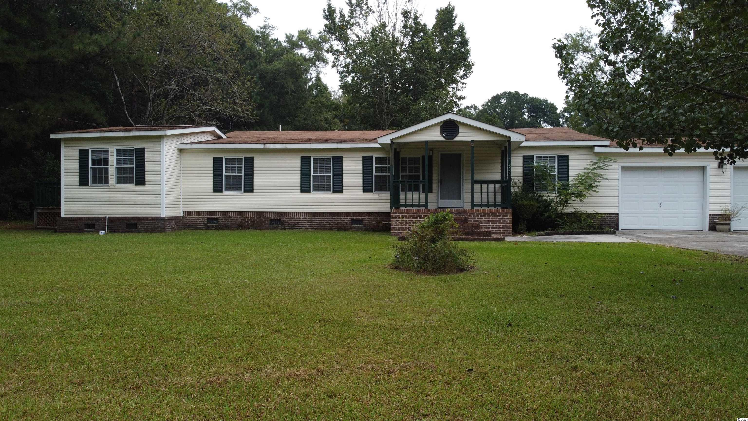 Three bedroom two bath home on two acres of land. There is also a manufactured home in the back that is included with this property. Square footage is approximate and not guaranteed. Buyer is responsible for verification.