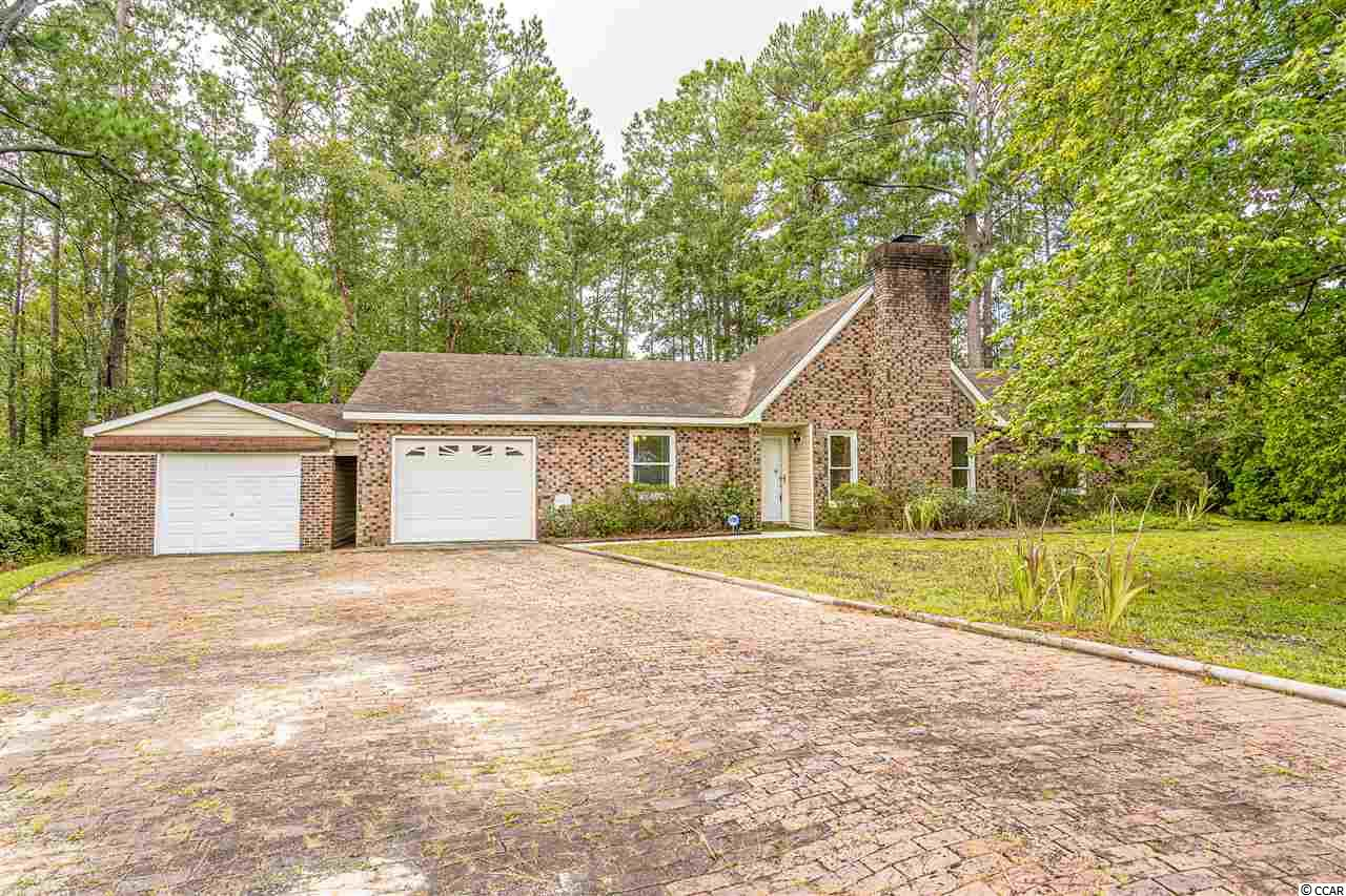 If you're looking for lots of privacy, but want to be close to it all, this is the place for you! Conveniently located just off of the intersection of Hwy 31 and Hwy 544 in the Sandy Pines neighborhood, this all brick home sits on 1.14 acres, has no HOA, is extremely low-maintenance, andhas been well-maintained by its licensed contractor-owner! It has a split bedroom floor plan and all bedrooms have carpet and ceiling fans. There's plenty of parking along the brick pavered driveway that leads to two garages: one is an attached 1-car garage and the second is a 1-car detached garage currently being used as a workshop, although it easily fits a car. Enter the home through the attached garage, and you'll land in a spaciousmud roomfeaturing wood-look, porcelain tile with a washer/dryer connection, water closet, and an additional closet for storage. Enter through the front door, and you'll find yourself looking into the large, open living room with gorgeous Brazilian cherry hardwood floors and gas fireplace with brick surround. The living room flows into the kitchen, which features ceramic tile flooring, matching stainless steel appliances, craft made solid cherry cabinetry with both under cabinet and in-cabinet lighting,and relatively new windows and doors that were installed in 2004. There's a built-in office nook and still plenty of room for a work island or dining table. Just outside the kitchen is your backyard oasis with a patio and trail leading into the woods where you can enjoy the majority of your property. The trail opens up to an area where the owner used to keep a vegetable garden, and continues on to where you can relax and enjoy the small creek. In the spring, you'll really enjoy your backyard as the surrounding azaleas are in full bloom! Rest easy knowing your property is protected with ahard-wired alarm system and motion detecting security lights. The HVAC is only five years old (and is still under warranty) while the hot water heater is only one year old