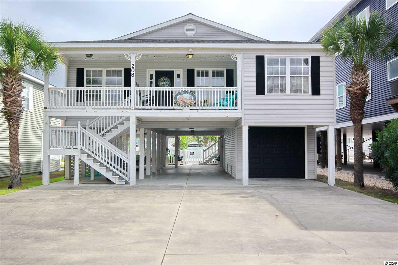 This is the one! Amazing 4 bedroom 3 bath Raised Beach House  just 50 yards from the beach and one block from the Cherry Grove Boat Launch. This home sleeps 10 comfortably and has been nicely updated with new LVP flooring, granite countertops and freshley painted. Nicely appointed furniture (see non-conveyance list). Open, light and airey, definitely the epitome of beach living. Enjoy the 2 decks, one in the front for relaxing in the rocking chairs, the other on the large back deck is perfect to gather for family or entertaining. The inground salt water pool is waiting for you on those really hot days when you want to cool off.