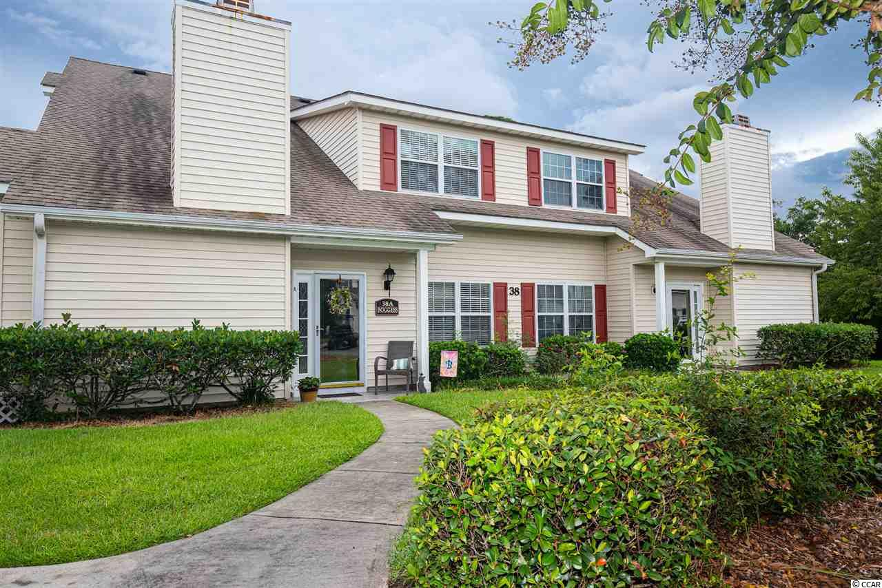 LARGE GOLF COURSE UNIT IN FAIRWAY OAKS!  This 3BR, 2.5BA unit is being sold FULLY FURNISHED and is MOVE-IN READY.  An amazing feature about this unit is its location.  This building is at the end of the complex, and the patio of this B unit faces the beautiful renowned Surf Golf & Beach Club golf course which surrounds this secluded community.  Enjoy amazing views of the golf course and ponds directly from your patio!  As a front unit, you also enjoy the convenience of parking in front of your unit making it a short distance from your car to the front door.  Two great advantages offered with this unit.  The master suite and half bath are located on the first floor and two guest bedrooms and full bath with double vanity are on the second floor.  Units in Fairway Oaks are townhouse-style and this complex is GOLF CART and PET FRIENDLY to owners.  A short walk or golf cart ride to the beach, and close to Main Street in OD with restaurants, shopping and entertainment.  This unit will not last long!  Square footage is approximate and not guaranteed. Buyer is responsible for verification.