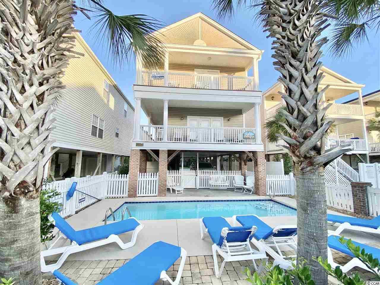 This beach house has it all! Enjoy your own private pool with heater, located across the street from Surfside Beach access with showers. Walk to dinner at the Surfside Diner, Bubbas, River City Cafe or Surfside Beach Pizza, all located near the Surfside Pier. The Surfside Library, tennis courts and playground are also just a short walk away.   As you enter this beach home, you're greeted with an open floor plan that is updated with granite counter tops, stainless steel appliances, crown molding, wainscoting and plantation shutters.  On the main level, you'll find the kitchen with countertop bar seating, casual dining area, family room, two bedrooms and a full bathroom. The second floor has four additional bedrooms and three full bathrooms. There is an option for a second master suite.  Enjoy the beach breeze and private pool view from your dual porch balconies on the main and second floors. This beach house has a steady rental history for the past ten years with Surfside Realty under the name Moore Fun.  The home, pool and landscaping is professionally managed and maintained.   *The majority of furniture in the home and televisions in every room convey with suitable offer. Seller will specify furniture pieces which does no convey. *Broker is related to Seller. *Buyer/Buyer's Agent to verify all information.