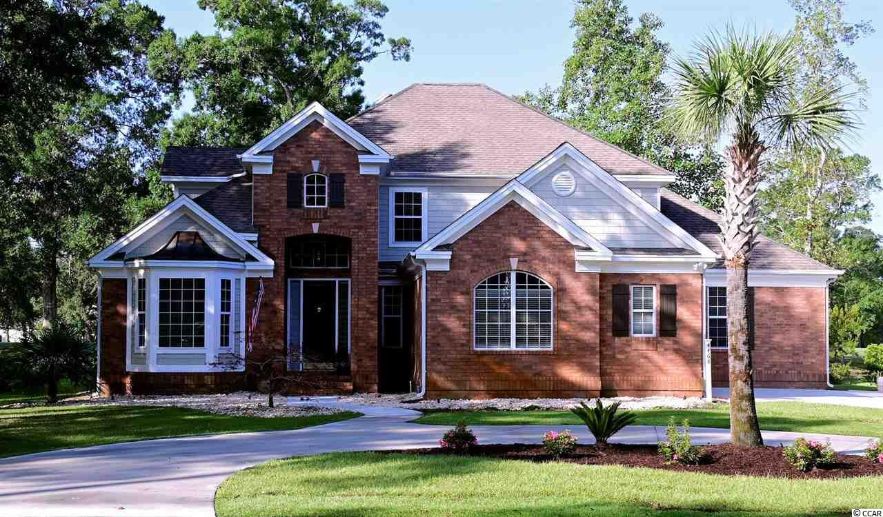"""OPEN HOUSE Sunday 9/20 1:00-3:00. Truly, a MUST SEE: To experience the attention to detail and quality of this better-than-new custom built, brick home! """"Upgrades"""" is an Understatement- The current owners have completely renovated inside and out; all in the last 12 months. Starting with the exterior: ALL siding, trim and soffits were replaced with maintenance free Azek (a PVC Material), new  gutter guards. New circular driveway and beautifully up-lit landscaping offer incredible curb appeal both night and day!   The WOW factor is ever present upon entering the foyer and light-filled, great room with soaring 18ft ceilings, pretty oversized ceiling fan, gas fireplace flanked by custom built-ins & spectacular windows w/ energy saving, remote-operated solar shades. Brand new Cortek Plus flooring (waterproof, cork backed & super durable) throughout the living areas offer a warm, inviting feel.  Entertainers dream as the wet bar with custom built-ins, lighting and gorgeous Quartzite countertop is adjacent to great room and kitchen. The entire interior has just been painted professionally. The formal dining room, adorned by chair rail and triple dental crown millwork connects to the fully renovated kitchen. All new stainless LG appliances, glass tile backsplash, pantry, espresso cabinets with wooden pull outs and under cabinet ambient lighting topped off with gorgeous Quartzite countertops! Eat-in area flows out through French doors to the bright sunroom with all new EZ Breeze slider screened windows and rear door leading to the all brick, raised patio with gas grill hook up! Relaxing 1st Floor Master Suite offers an adjoining multi-funtional room that could be converted to 4th bedroom easily with full guest bath just across the hall.  Master bedroom has cathedral ceiling, oversized bay window overlooking the 17th green, fairway and tranquil pond. Master bath has separate (elevated) vanities, step in shower w/ new glass door, garden tub with custom stained glass window and"""
