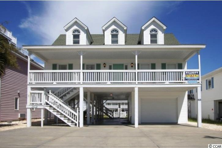 Bring the family and come make this piece of heaven your own before its gone. Enjoy all that Cherry Grove Beach has to offer from fishing in the channels, to paddle boarding in the creek, laying out at the beach, and swimming in the ocean. With only a short walk or golf cart ride to the beach you will be only minutes away from your Tropical South Carolina Paradise. Enjoy the beautiful sunrises over the ocean and sunsets over the channels in your own private beach home. This property boasts 5 bedrooms, 3 Bathrooms, Granite Countertops, Vaulted Ceilings, Spacious Decks, Plenty of Storage Space, and a Private Owners Closet Downstairs. This home has been upgraded with tons of extras! Not to mention all of the fine dining, shopping, and entertainment that North Myrtle Beach has to offer! Call today to schedule your private showing!