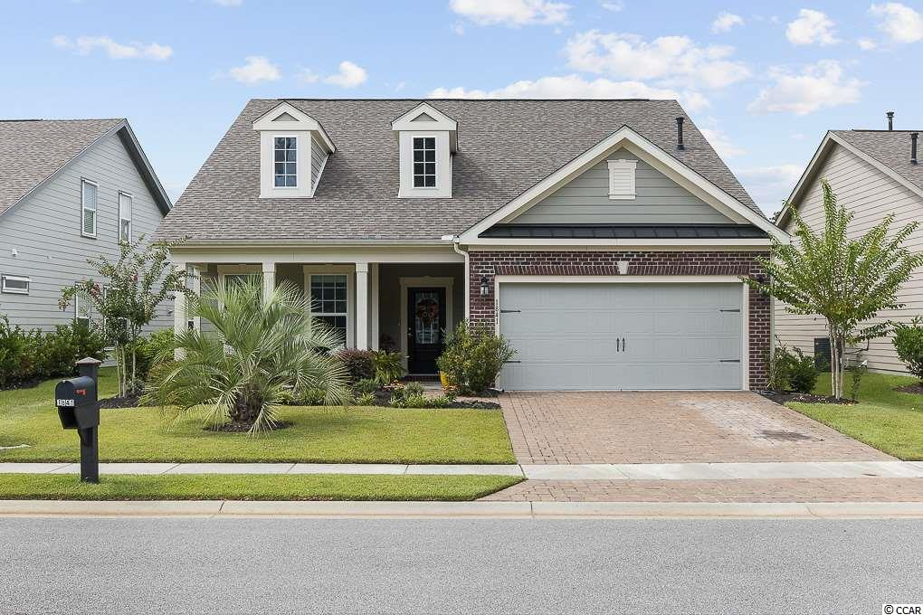 Welcome home! This is the time to enjoy the abundant Market Common lifestyle in your home in The Reserve. Market Common is Myrtle Beach's first and only urban community, less than a few miles to the ocean and airport. This home was originally built by Beazer Homes and is the Augusta floorplan. Walk up the extended driveway and walkway that is made of pavers to the  front porch. Enjoy sitting out there and enjoying a coffee or the breeze with privacy behind the Pindo palm. This home features 3 bedrooms, all of them on ONE FLOOR, 2 of them are up front along with beautiful french doors that lead to an office. Walk down the hardwood foyer the open kitchen featuring granite countertops, under cabinet lighting, upgraded cabinets, built-in wine rack, pantry, a gas range, and breakfast nook. The spacious owners' suite is separate from the other two rooms, toward the back of the house. Enjoy the same hardwood floors throughout the living areas as well as the owners' bedroom. French doors open to the ensuite with granite countertops, double sinks, tile floor and stunning, oversized, tile shower with two showerheads and a bench. The large walk-in closet is off of the bathroom and features hardwood as well. There is also a separate laundry room, 2 car garage, stairs to the attic, and a landing area inside the home from the garage. Walk off of the living room and onto the screened porch with a painted floor, ceiling fan, and swing. The patio outside of the screened porch is made of pavers and is the perfect place for a grill. The landscaping is mature and provides nice privacy.There is a keyed clubhouse and pool that is exclusive only to The Reserve. Shopping, restaurants, parks, gyms, the movie theater and entertainment at The Market Common await. Bike, walk, run, or golf cart around this beautifully developed and manicured neighborhood to the trails or the pool.  The Myrtle Beach International Airport is less than 10 minutes away and so is Myrtle Beach or Surfside Beach. Come and experience this home, this neighborhood, and this community, you'll feel right at home!