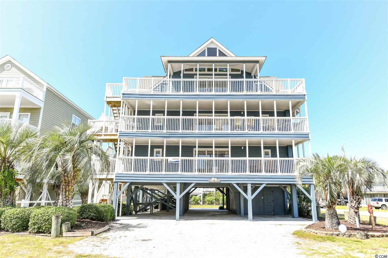 "This fully furnished 10 bedroom property offers 3 levels each equipped with full kitchen, living area, and washer/dryer. Each level is accessed by exterior steps and can be rented by level if preferred. This ""2nd row"" property sits on a double, corner lot located on Ocean Blvd and 5th Ave.  It offers an easy and convenient walk to the ocean. Private pool behind the property with covered parking under the house. This is a must see property!"