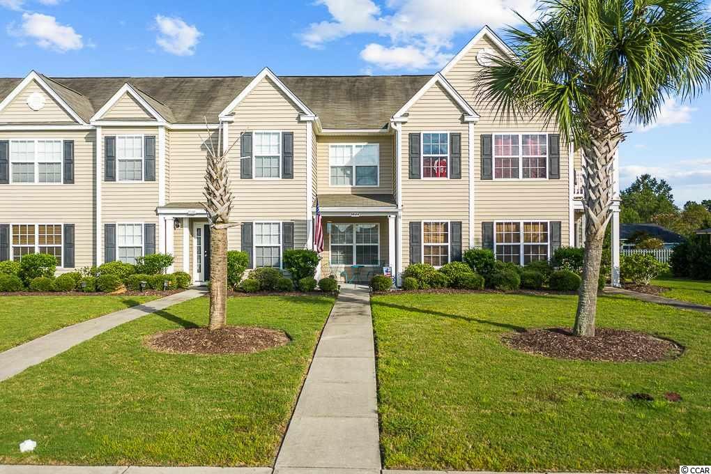 Welcome home to this townhome in the heart of Myrtle Beach in the neighborhood of Tuscany. This townhome would make a great primary residence, first home, second home, or investment opportunity. It is versatile and low maintenance! Park in the rear of the townhome and have plenty of space for two cars and convenient overflow parking right behind the driveway. Enjoy some outdoor space that is maintained by the HOA and have the opportunity to sit out back and grill. There is also additional storage outside. The kitchen has plenty of counter space, a pantry, breakfast bar and breakfast nook. It opens to the spacious living room that has a ceiling fan, plenty of wall space and also has a convenient half bath. Walk up the stairs to the two bedrooms that have upgraded luxury vinyl plank throughout.  Both bedrooms have their ceiling fans and full bathrooms.  Tuscany residents have access to the resort-style amenity center that features a beautiful two-story clubhouse with swimming pool, lazy river, large fitness center, game room, 24-seat movie theater, lighted tennis courts, nature trails for hiking, 60 acres of conservation, sidewalks and more.  Just minutes to shopping, dining, beaches, Myrtle Beach State Park, Myrtle Beach International Airport and several golf courses.  This home has been well maintained and ready for the new owner, schedule your showing today!