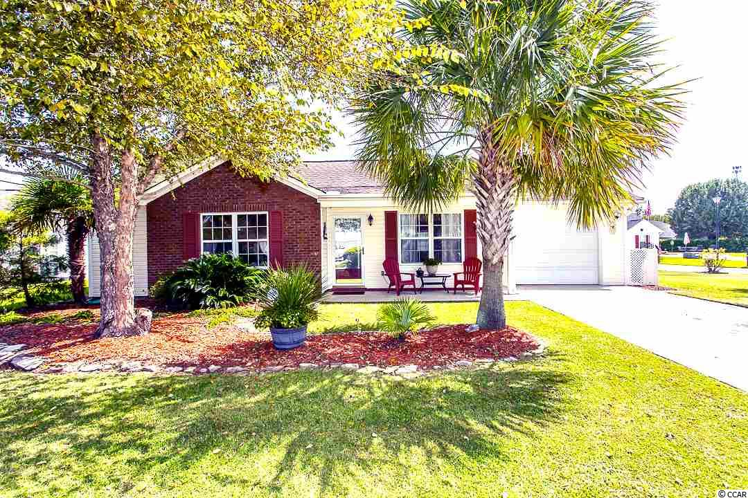 Very well maintained 2 bedroom 2 full bath patio home located in Golf Forest section of Colonial Charters.  Golf Forest includes only 52 homes and is just a short drive to the sandy beaches of North Myrtle Beach and easy access to Highway 9 and 31. Home is located on a corner lot and features a 1-car garage (13x23 feet), open floor plan with vaulted ceilings, brand new laminate Traffic Master flooring in living and hallways (Nov 2020), good sized bedrooms, a cozy screened-in patio (12x8 feet), privacy fencing in the back and community outdoor pool at the clubhouse.  Stainless steel appliances (5 years old). Mailbox is located outside of the home as well which is rare for the community.  New HVAC installed 2014.  Water heater replaced September 2020.  Two storage buildings also located in the back yard.