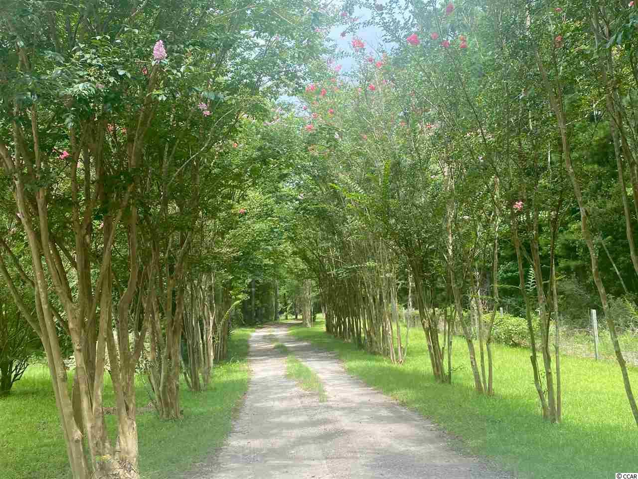This private 3.5 acre property was once a beautiful piece of property before previous owners let it go. It has gorgeous mature Crepe Myrtles and would make a beautiful private homesite. The doublewide mobile home on site could be fixed up but will require a lot of work to make it fully livable. Under current zoning you can build a shop or warehouse, you can also subdivide property into 5 lots or keep all of this beautiful property to yourself.  Managing Member is Licensed Realtor