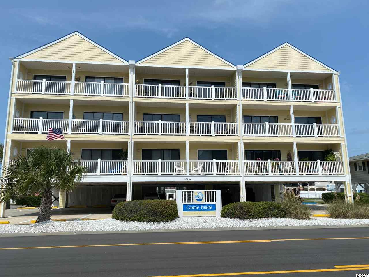 Gorgeous turn key 2 bedroom 2 bath second row condo in the very sought after Grove Pointe Condos in Cherry Grove. This unit has all the upgrades you could want with ocean views and easy beach access across the street. The unit has sliding glass doors to a balcony that runs the length of the condo with added screen doors to enjoy the breeze. Master bedroom has private balcony entrance and plenty of space. The unit has beautiful remodeled bathrooms, kitchen and comes furnished. There is storage area under the building for your beach toys and chairs and also a storage closet outside the unit. This a perfect second home or rental property to start enjoying right away. Grove Pointe Condos is only a few blocks from the Cherry Grove fishing pier and a short golf cart ride or walk to grocery, shops and dinning.