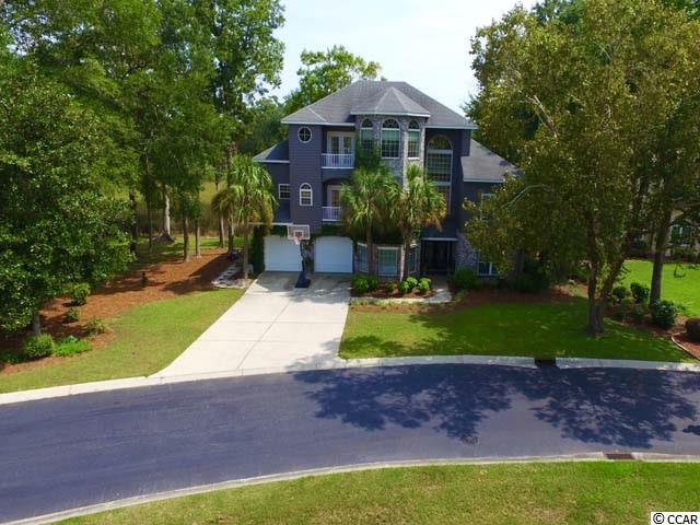 Are you looking for a safe ,quite, and small community located just outside of the Grand Strand ? Do you need room for Mom, Dad or extended family? Do you like to Golf at World Class golf courses ? Do you like Fishing, Kayaking ,Boating and going to the Beach ? Well then , look no more !! Tucked away in one of the most sought after double gated communities you will find your dream home . This home boast 3 levels of breathtaking views that include the marsh and Inter-coastal waterway . Community pool , clubhouse ,boat dock , beach and fishing areas are just steps from your front door .  First level entry gives access to (2) 400sqft areas of flex room and/or in-law suite with a walk-out covered patio . Second Floor is a open concept with Living room ,Formal Dinning, Kitchen with breakfast bar and nook , Laundry room  , Balcony off of the front , (2) Bedrooms, (1) Full Bath ,and (1) Half Bath. Step out (2) sets of new doors onto your large back deck and watch the wild life and boats go by . It's perfect for relaxing and entertaining. Third floor is the owners suite with a large sitting area or office . Master has a large walk in closet, smaller sitting area , a balcony off the front ,large deck off the back and master bath with over sized tub, large walk in shower , double sinks and a fire place !! Beautiful Hardwood floors throughout with neutral paint colors make it easy to decorate to your liking . Plenty of room in the Attic for storage as well as a 2 car garage. Side lot is yours to put in pool or play area for kids and pets !! This property wont last long so make your offer today !!!