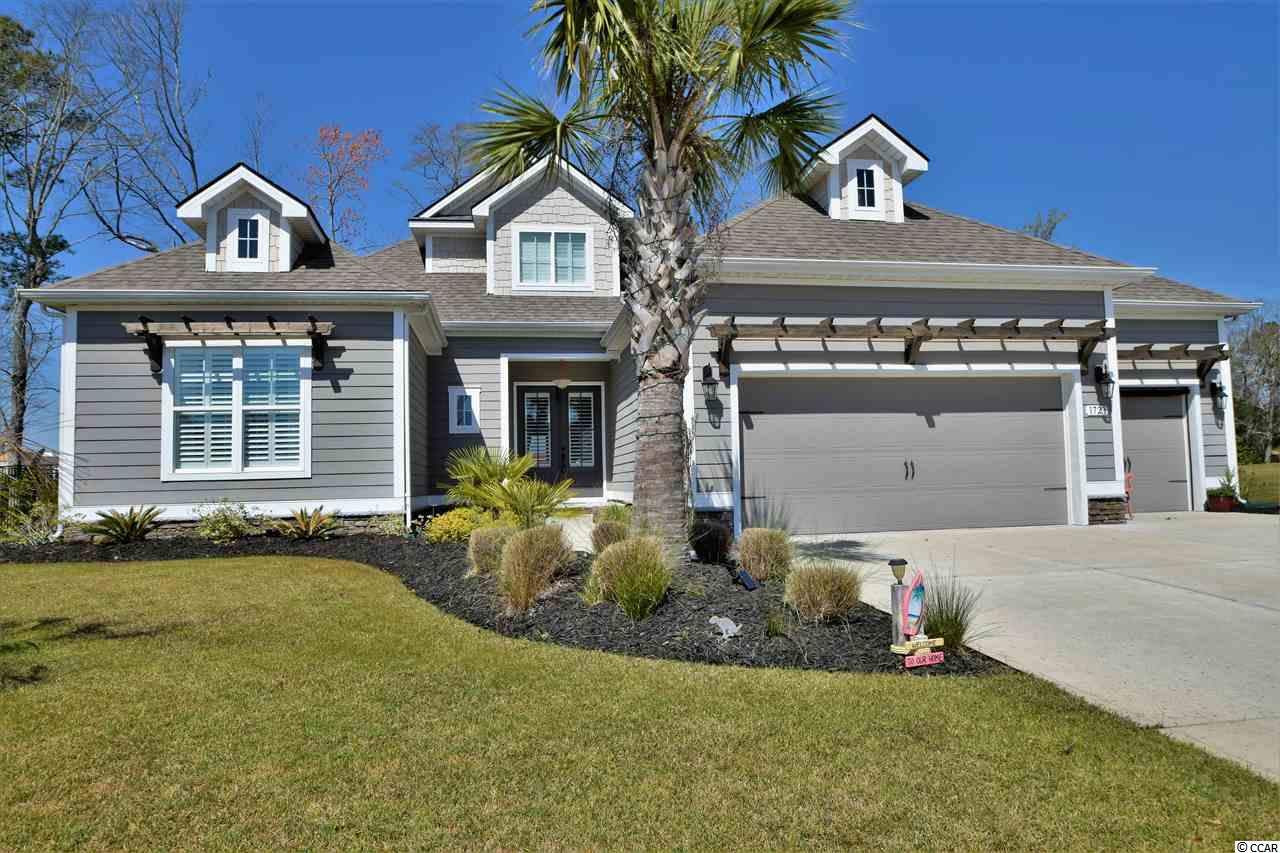 "Absolutely stunning CUSTOM designed home in North Myrtle Beach's gated Seabrook Plantation!  Custom details and upgrades are packed into this one of a kind property. Enjoy living in a home that fits the coastal surroundings! The ""Citadel"" floorplan offers five bedrooms, three and a half baths, and a spacious feel with tall ceilings and an open concept living area. The attention to detail and craftsmanship in this property is a true find and make it one of the best in the neighborhood!!  Owners have maintained this home in immaculate condition. Three bedrooms downstairs (including the master) and two large bedrooms on the second floor offer plenty of privacy in this spacious home. This floor plan has only been built twice in the neighborhood. Featured throughout this home is an extensive Craftsman trim package, heavy crown moldings, bead board wainscotting, cottage doors, plantation shutters, and oil rubbed bronze hardware. Flooring upstairs and down is a wide 7 inch plank, hand scraped hardwood; wood look tile finishes off all of the wet areas. You will find a kitchen fit for entertaining complete with a large island, granite counter tops, stainless appliances, natural gas range and custom lighting. Plenty of storage space with bead board accent cabinetry and upgraded roll out drawers. The laundry is conveniently located just off the kitchen. Truly an owner's retreat; the first floor master bedroom and bath are made for relaxation. The bath has a large walk in shower with classic subway tile and glass enclosure. Ready to enjoy the great beach climate? Take advantage of the outdoor living space with a large screened patio featuring access from the living room and master bedroom. Lots of green space in the back and side lawn, fully fenced in ornamental aluminum and easily maintained through an automated irrigation system. The surrounding lawn has been tastefully landscaped with a pretty pond front lot location.  Other property features include a dual zone HVAC system, tankless hot water heater, and security system. Large three car garage with built in work space and extra storage room; there's also plenty of parking for your golf cart! The community is a ""natural gas"" neighborhood. Seabrook Plantation owner's enjoy access to a community clubhouse and large pool. Easy access by golf cart to Cherry Grove Beach.  Low HOA fees and located in one of North Myrtle Beach's premier neighborhoods.  No flood insurance is required in this location.  Don't miss this great opportunity to move right into the coastal lifestyle!  All information is deemed reliable, buyer is responsible for verification."