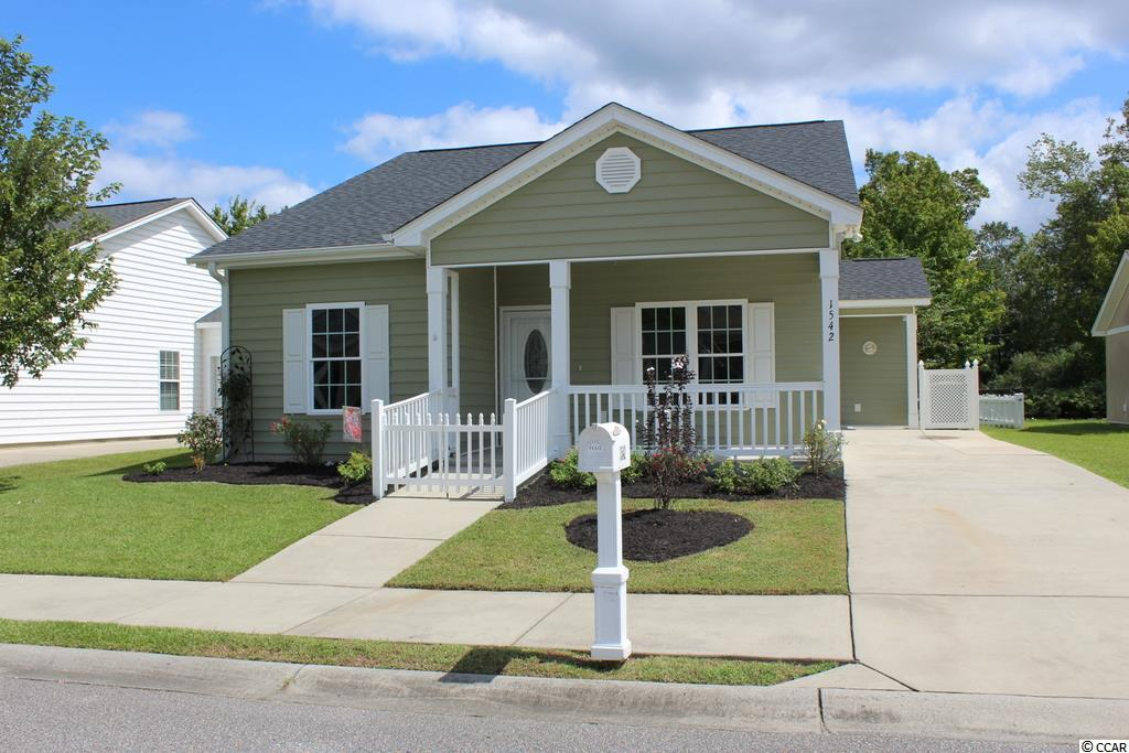 "Located in a small community with sidewalks, not far from historic downtown Conway, you will find this charming home. The front covered porch provides a perfect area to relax in your rocking chairs while enjoying your morning coffee. Large open living area has a vaulted ceiling with ceiling fan and lots of windows. The kitchen has stainless steel appliances including a side by side refrigerator, lots of cabinets with crown molding and counter top space. There is a breakfast bar and an adjoining laundry room/pantry area. The kitchen is open to a large dining area with french doors to the rear screened porch. There is an attached storage shed as well as the fenced back yard. Spacious master bedroom with tray ceiling and ceiling fan, large 13'8"" walk-in closet, bath with 5' walk-in shower, vanity and a linen closet. The large guest bedroom is located in the front along with a full bath and additional storage closet. Gutters. The home has been freshly painted and is move-in ready. While you enjoy this historic town you will also be within a 30 minute ride to the beach. All measurements are approximate and not guaranteed, buyer is responsible for verification."
