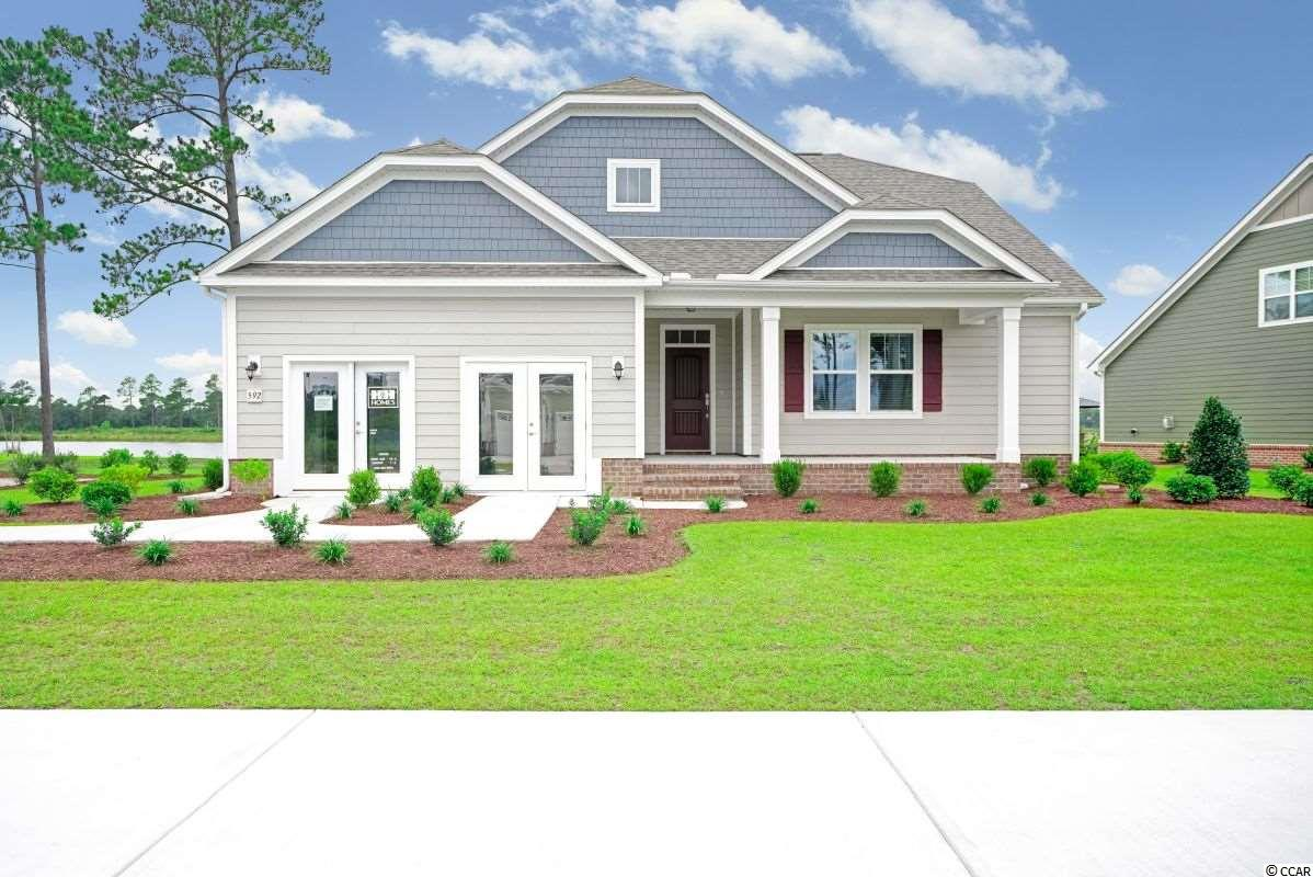 """The Calabash 2 story floor plan. Our newest addition to the HH Homes line up here at Indigo Bay in Carolina Forest. This home will be on the lake.   This home will  be built with  3 bedrooms, 3 baths and study, and bonus room. A casual bay window has been added along with a door from the Master bedroom to the porch. There is still time to personalize this home with your own chosen features and colors. Call the listing agent for details or stop by our model at Indigo bay.    The Calabash plan has low country style with cement fiber board exteriors & raised slab brick veneer foundation.  Some standards included in this home are large front and rear covered porches, laminate 5"""" flooring throughout all 1st floor common areas, over sized tile walk-in master shower. Natural gas water heater, gas heat. Maple 36"""" - 42"""" staggered height cabinets with crown. Granite kitchen counter tops, counter height kitchen island peninsula with granite overhang. Tray ceiling in master bedroom. Stainless appliances, The new Chrome lighting & plumbing package. Comfort height vanities in all baths. Fully finished garage with side access door. Upgraded trim package including 7.25"""" baseboards throughout, cased windows & openings, crown in the foyer and dining room. Paver apron driveways, Fully landscaped, sodded & irrigated yard with gutters around entire home. Eco select energy program with 2X6 exterior walls, R19 insulation, radiant barrier and trane 16 seer HVAC unit, and comfort guarantee, TAEXX Built-in pest control system. Sentricon termite system. 2 - 10 warranty.  Living in Indigo Bay you will be enthralled by sites & sounds of Nature. Centered around a 56-acre Lake is the backdrop to where you can enjoy kayaking, canoeing, paddle boating, fishing.  You will also enjoy walking through the neighborhood on our spacious 9' wide Recreation path. Our 2-story Clubhouse Amenity Center with front & rear wrap around covered & screened porches, Community pool & fitness center. We even have a dog"""