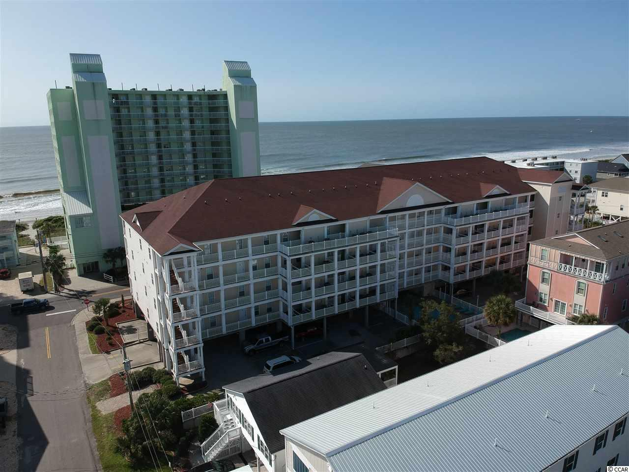 You don't want to miss out on this two-story, over 3000 sq. ft. turnkey condo with ocean views located second row in the family-friendly Cherry Grove section of North Myrtle Beach! Perfect for a second home, primary residence, or investment property. The property is fully-furnished with five bedrooms and five full bathrooms. This unit is open and spacious with large balconies off the main living area and the top floor two master bedrooms. Enjoy one main floor bedroom with an ensuite bathroom with a jet tub and a separate walk-in shower. The kitchen features granite countertops, a large work island with bar seating, two stainless steel refrigerators. One master bedroom has an ensuite bathroom with a jet tub and a separate walk-in shower. At the top of the stairs, enjoy another living area/game room. Owners are allowed pets, golf carts, and motorcycles. The property features a large outdoor pool, hot tub, picnic area with charcoal grills. Walk right across the street to the beach or a short walk to the Cherry Grove Park &  Boat Ramp and the Heritage Shores Nature Preserve. Close to all the entertainment, North Myrtle Beach has to offer.