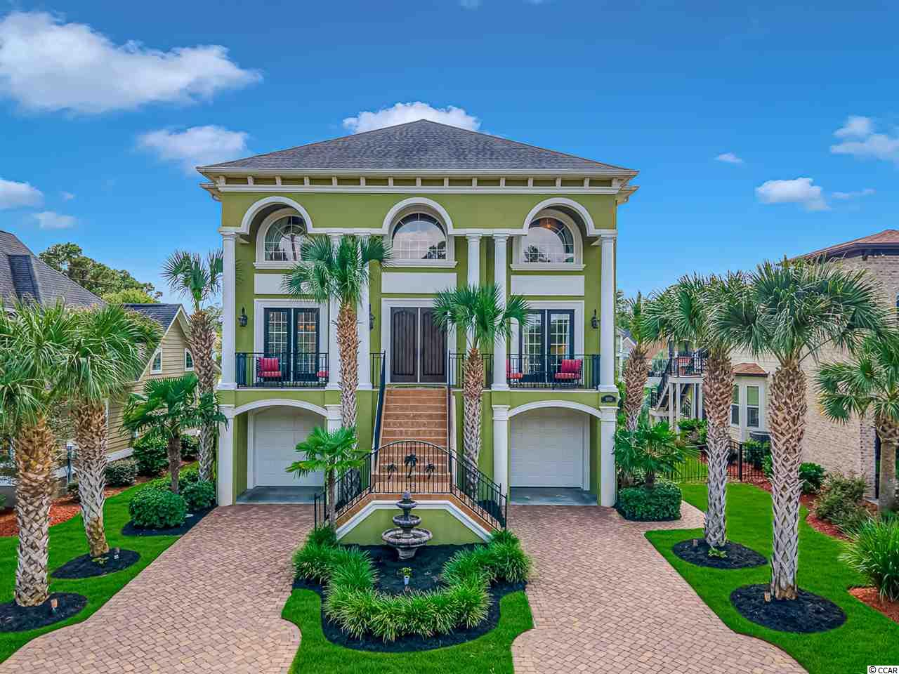 "Located within the ICW community of Sunset Harbour, this majestic custom built home is ready for new owners.  The detail, custom finishes, and upgrades are something you will have to see for yourself!  Walk up the grand staircase to your beautiful front door which opens to a grand foyer where the bifurcated staircase with wrought iron railings will draw you in (one sweeping set of steps that splits off into two smaller flights going in opposite directions). Gorgeous Brazilian Cherry hardwood flooring carries you throughout the main level with a formal dining room, office, half bath, great room with a fireplace, and a kitchen with breakfast nook.   The custom ceilings, designer moldings, 8' solid core doors, surround sound, central vacuum system, laundry chute, and water filtration system are sure to please even the pickiest of people.  The kitchen boasts granite counter tops, stainless steel appliances with cooktop and wall oven and microwave, large island with prep sink, a breakfast bar and nook.   Up the grand staircase to the 3rd level and you will find the perfect place at the top to sit and read a book in the loft that overlooks the front yard.  On one side you'll find two bedrooms and a full bath, and the other side features a bedroom with an en suite bathroom and the luxurious master suite.  The suite measures 16'10"" by 18' with a presidential tray ceiling and a 14' by 8' master lounge that leads to the covered terrace and a master retreat equipped with custom cabinetry, double vanity, garden tub and shower.  It is the perfect intimate escape for a restful night.  The 1st floor is garage space-it will accommodate 4 vehicles and has walk in storage.  Outside, along with a beautifully manicured yard, you will find triple porches on the back, a side screened porch, composite Trek decking and an irrigation system."