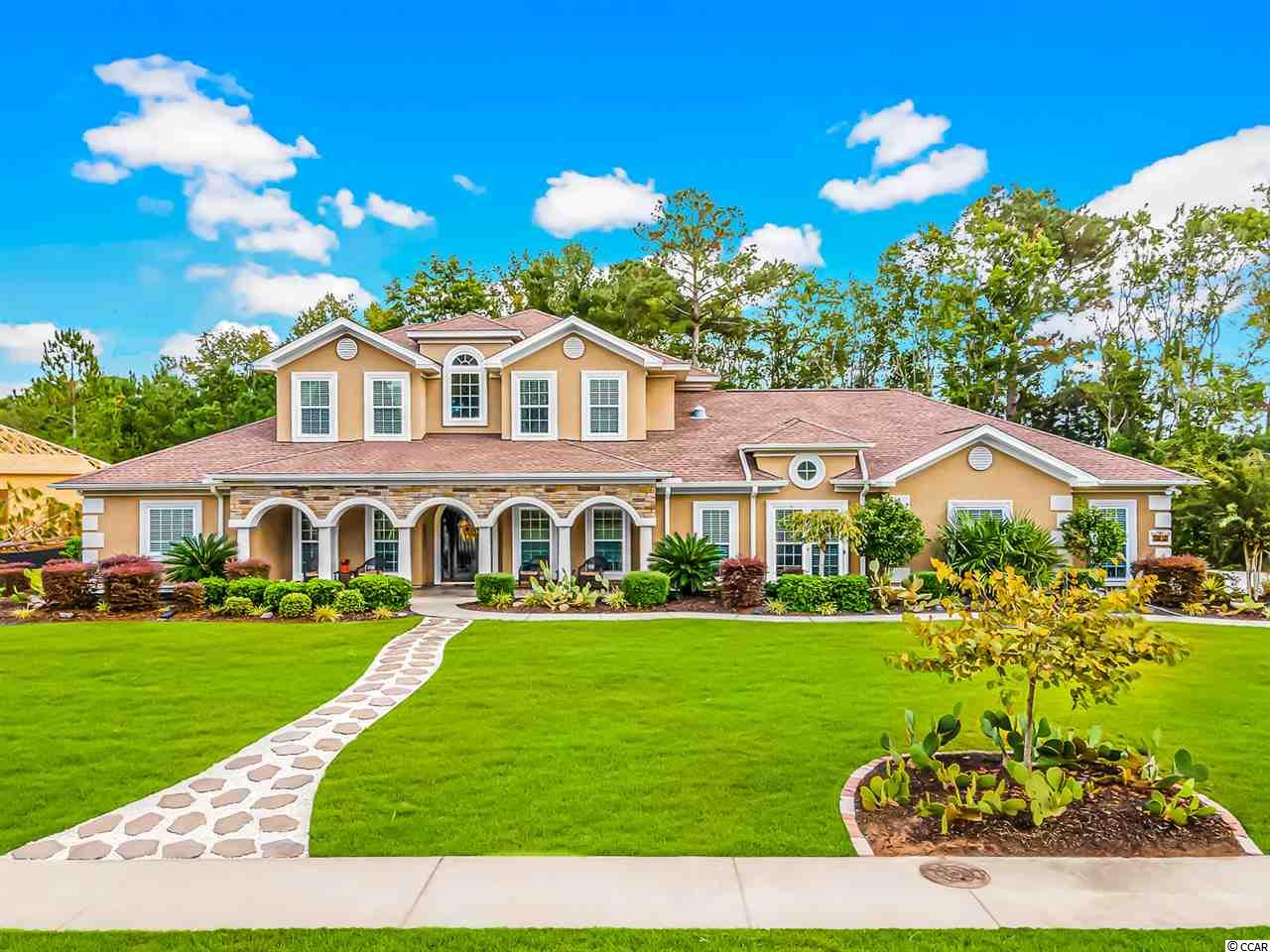 Come see this one of a kind custom award winning home, designed by owners, built by Majestic, in Wild Wing Plantation. This spacious 4 bedroom, 3.5 bath home, 3,448 ht. sq. ft., 4,836 sq. ft. under roof, is located on large .71 acre lot located on the 2nd hole of Wild Wing Hummingbird Golf Course. The home features Hardwood Brazilian Cherry floors throughout the home. Enjoy the spacious living room, with high cathedral ceilings and gas vented fireplace. The upgraded kitchen features a large island, gas range, vegetable sink, upgraded cabinets, & available to include a wine chiller. The attention to detail with mosaic tile in the home and 5.1 surround sound in great room with speaker system in all rooms of the home, as well as outside front & back porches. Hurricane rated doors and windows are throughout the home. The solar package installed includes solar attic fans & solar tube lighting. The large master bedroom, with tray ceilings, offers 2 walk-in closets, and opens up to a spacious master bath. Enjoy the heated floors getting into your whirlpool tub or large walk in shower. The office could be converted into a 4th bedroom. Entertain guest in the upstairs living space includes princess suite equipped with another bedroom and full bath. The 2nd living area has hot/cold pipes ready to have a wet bar installed. Enjoy the privacy on your newly installed screened porch. Fully pavered patio will lead you to your private jacuzzi. The oversized full 3 car garage features plenty of storage. Enjoy all the amenities including clubhouse, pool, and tennis court. Close to all shopping, restaurants, and attractions Myrtle Beach has to offer. Founders Golf membership could be included, with offer to 21 award winning golf courses.