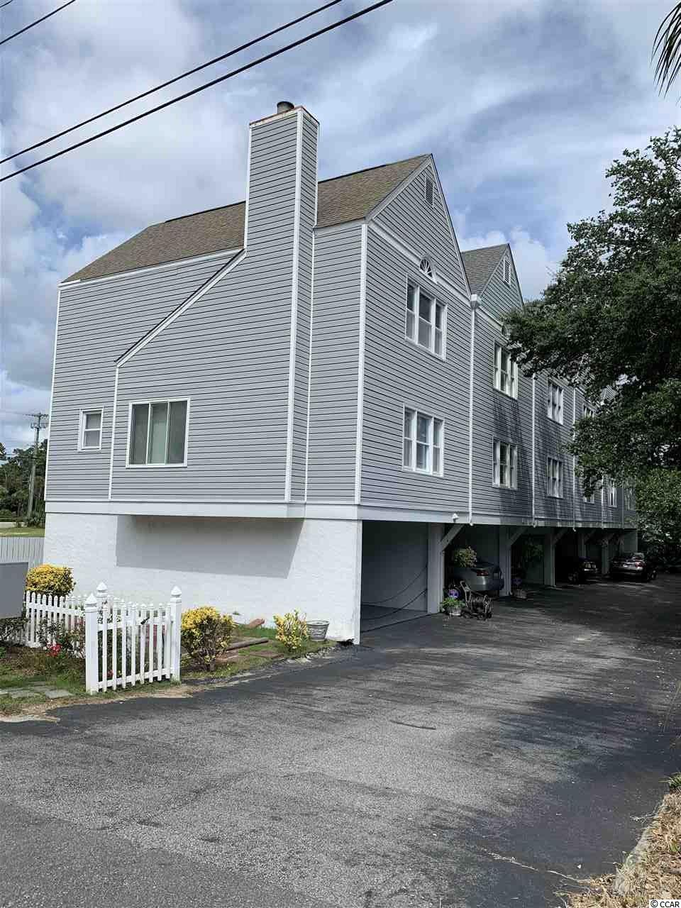 Look no further! A very rare opportunity to own a townhome with two car carport located under the unit and just a short walking distance to the Atlantic Ocean. Do not wait to call this townhome your perfect beach getaway home or make it into a great investment opportunity as short and long term rentals are allowed. This condo is conveniently located to all the main local attractions our Myrtle Beach area has to offer.