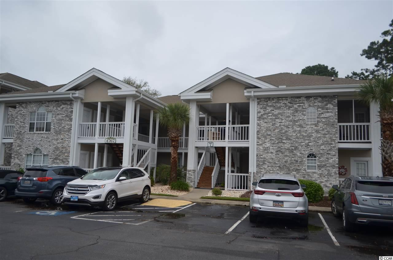 Welcome to this Beautiful 3 Bedroom, 3 Bath, First Floor End Unit in the well-desired Magnolia Place, Just a Couple of Miles from the Atlantic Ocean.  This condo has many upgrades.  This condo features 2 Master Suites with Master Baths.  The Kitchen has had all New Custom Cabinets and Granite counter installed. High Performance Engineered Wood Flooring and Tile are throughout the home. The Living area is Large great for entertaining family and guests, or just relaxing.  The Extra Large Covered Patio Looks out across a huge green space and beyond to Myrtlewood Golf Course. Truly a peaceful setting and a wonderful condo waiting to be yours.  Close to all the Activities and Entertainment Myrtle Beach and the Grand Strand has to offer.