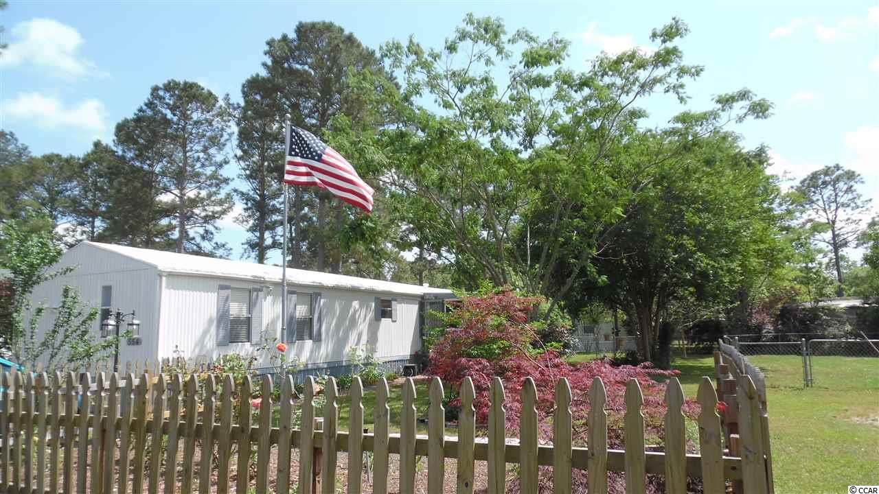 Quiet Living between Surfside Beach and Conway- Hwy 544 Area. Large 3 Bed/2 Bath on a Large Lot with a Screen Porch and large fenced yard. Close to everything that Conway and Myrtle Beach has to offer- AreaShopping, Colleges, Hospital, Rivers, and plenty of Yummy Restaurants. Pet friendly. Split Floor Plan Vaulted ceilings. Vinyl Siding.New fixtures. Ceiling fans, Designer Kitchen, double sink, and Dining area, - Newer appliances- large refrigerator, range, and dishwasher. Plenty of Kitchen cabinets and storage. Laundry room. Large Master suite with walk-in closet, master shower, and vanity. Second Bath with tub/ shower, and vanity. Large Lot. Large Utility Storage Shed. Shade Trees, Dogwoodtrees, Palms, and Plenty of room for flower beds and a garden. Lots of room to add-on. Call your Agent Today to Schedule a Showing!Must Come Visit!